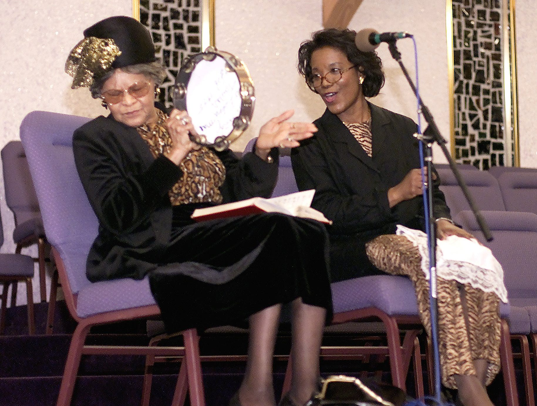 "2003: Edna Taylor, left, and Michelle Oliver perform ""Swing Low, Sweet Chariot"" Sunday through a dramatization in song during a Black History Month celebration"