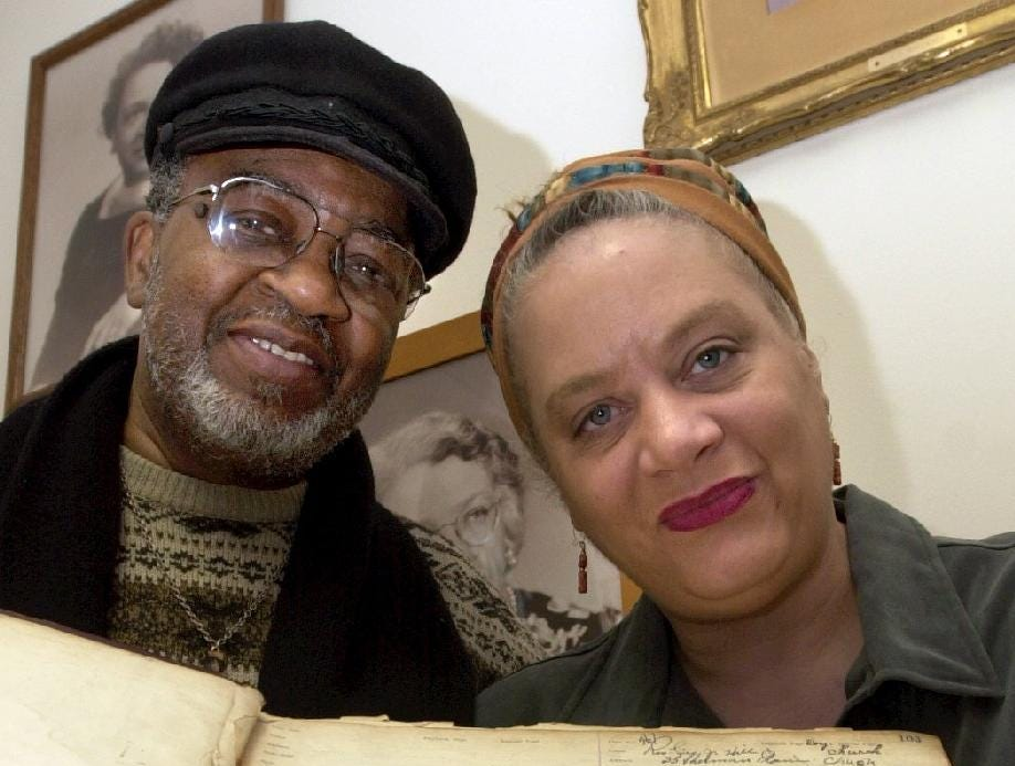 2004: Fred and Brenda James, members of the Trinity AME Zion Church in Binghamton's First Ward, hold the church ledger that shows abolitionist Jermain Wesley Loguen preached at the church from from 1860 to 1867.