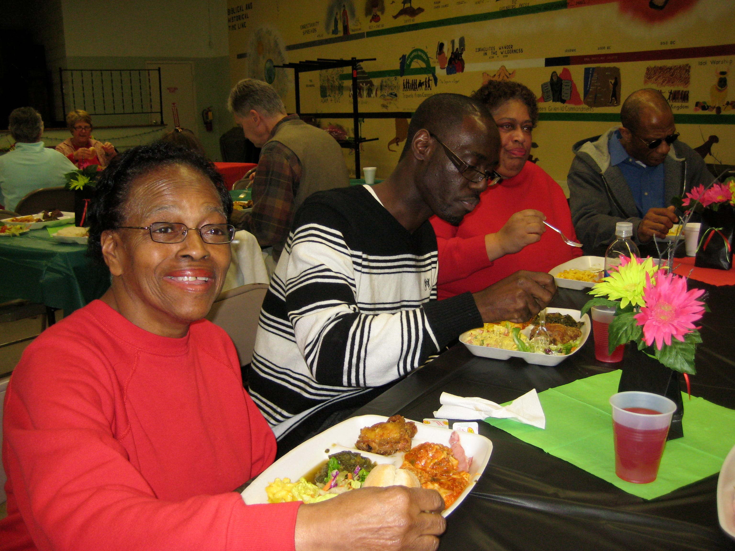 2011: Edie Phoreman, left, hosted a Black History Month dinner at her Binghamton church on Friday. Peter Holoman, center, the first boy to come under her tutelage in Double-Dutch, some 30 years ago. To his left is Phoreman's daughter Rita Phoreman.