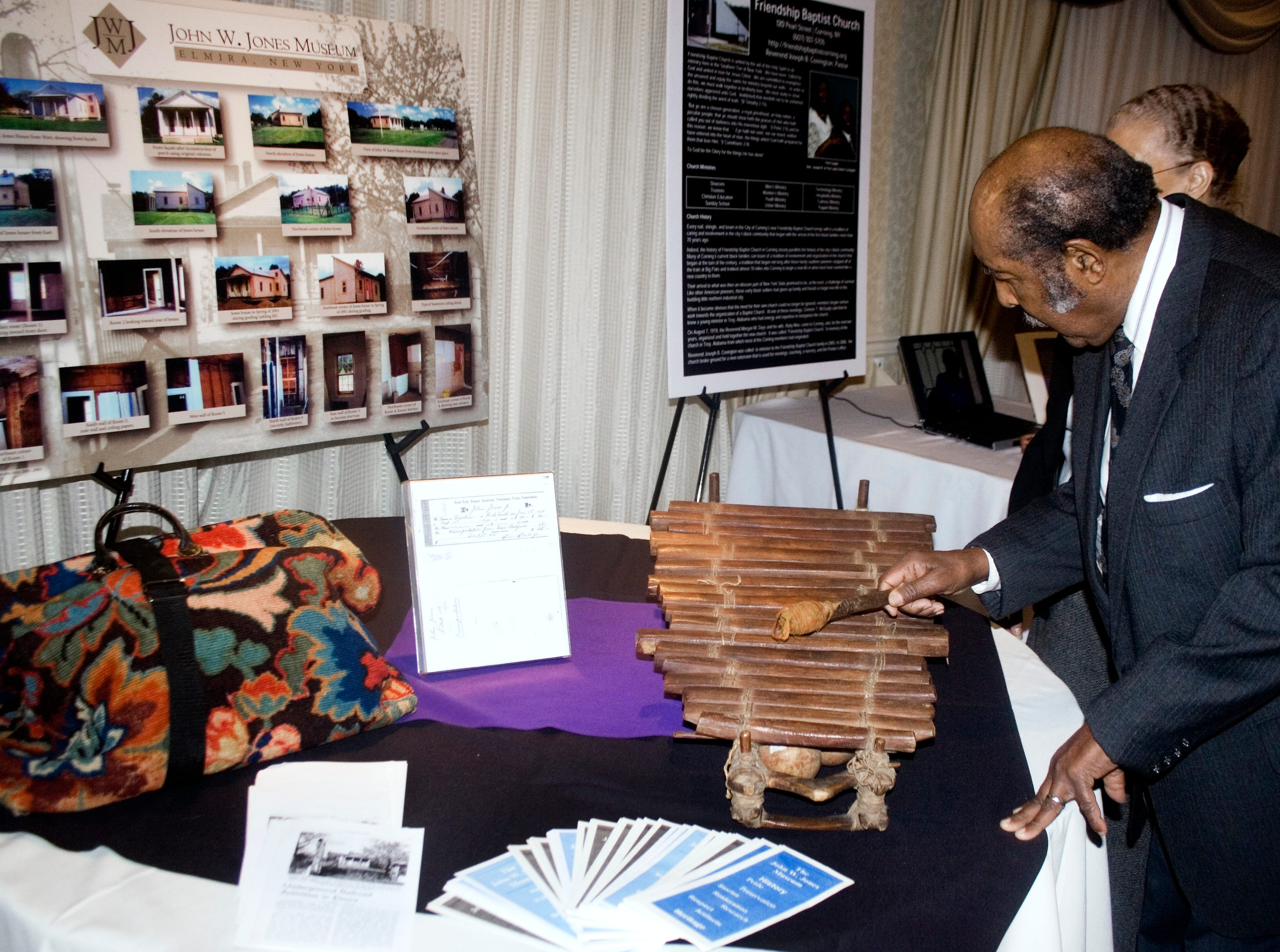 2008: Lloyd Mapp checks out a xylophone that's part of the John W. Jones Museum collection. The items were among numerous artifacts on display Sunday at the Hilton Garden Inn in Big Flats to observe Black History Month.