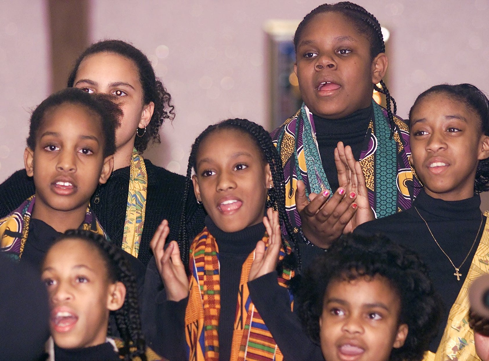"2003: The Community Children's Choir, directed by Ethel Stroman, performs ""I Am a Promise"" during a Black History Month celebration Sunday night at Faith Temple Community Church in Elmira."