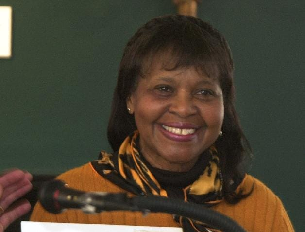 2004:  Jones Terry smiles as she receives posthumous World War II medals awarded to her late uncle John Honey Jones during a Black History Month event held at the Tioga County Historical Society. Jones, who died in July 2000, set up a trust fund to foster education and knowledge concerning the history of African-Americans with the emphasis on the Village of Owego.