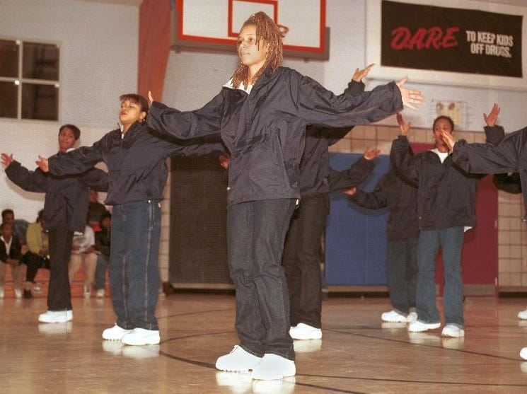 "1998: Tara McCray,16, of Binghamton (center) dances with her fellow members of The Right STEP team at Thursday evenings ""Music the Beat of Our Souls"" program to celebrate Black History Month."