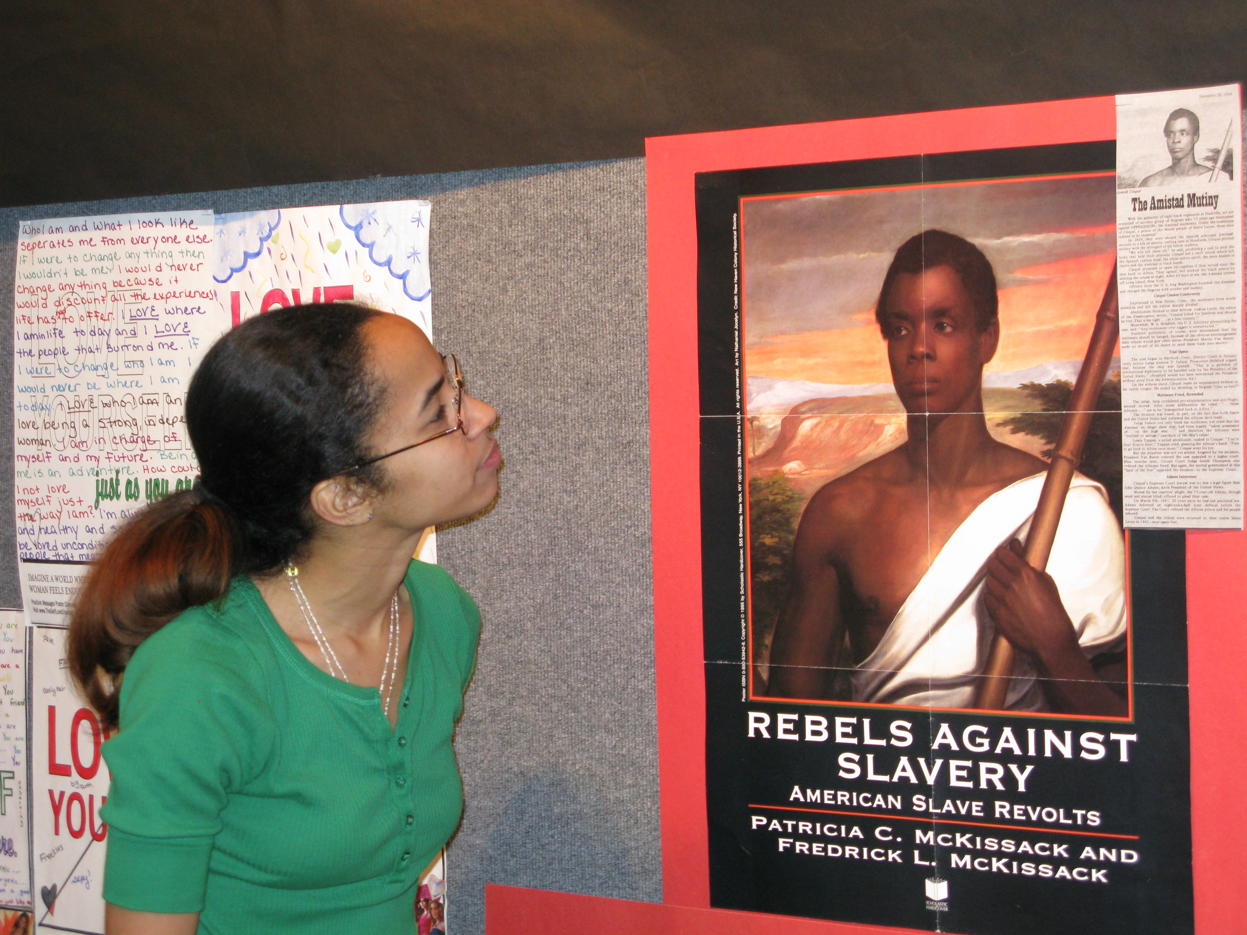 "2008: Mansfield University senior Sharon Thomas, looking at a Black History Month poster in the university's student center, is happy to be a leader on campus. ""It has been an awesome experience here at Mansfield,"" she said. ""I feel like people should give back."""
