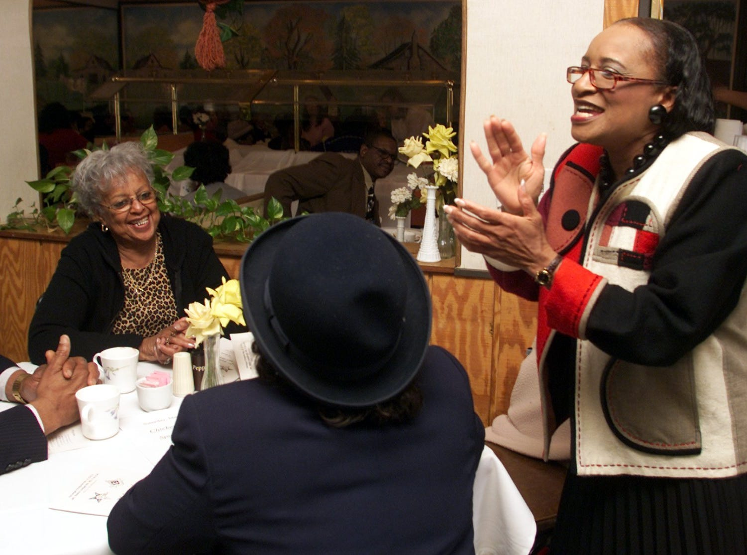 2002: Ernestine Kyles of the Omega Chapter No. 2 gets the crowd singing Saturday during a gospel brunch at Granny's in Elmira Heights. Members of the Monumental Baptist Church Youth Choir also sang at the restaurant, which was holding the brunch as a part of Black History Month.