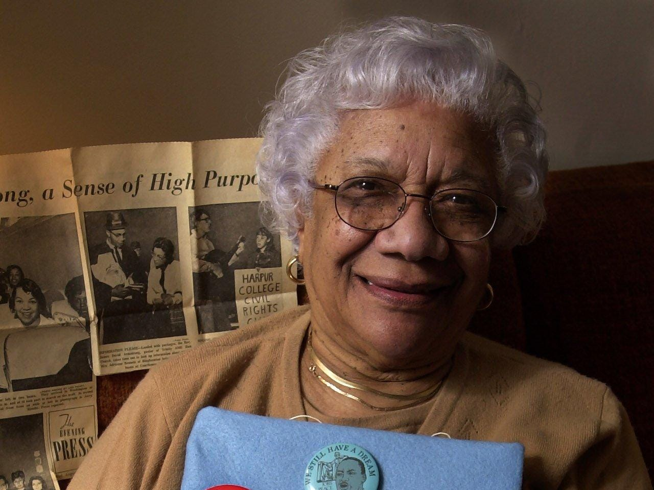 "2001: Genevieve Taylor of Binghamton with her collection of buttons from marching with Martin Luther King, including the ""I've Got a Dream "" civil rights march in Washington, DC Aug. 28, 1963."