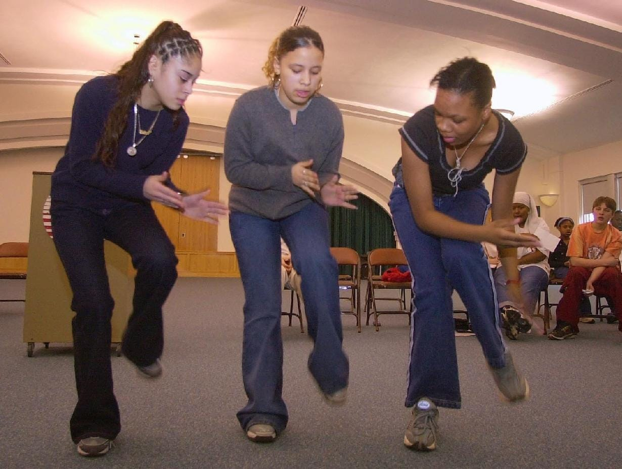 2001: Students, from left, Racquel Franco, Amy Ramos, and Kristen Thompson, all 14, perform the traditional step dance Wed during a Black History Month program at the Columbus Alternative School in Binghamton.