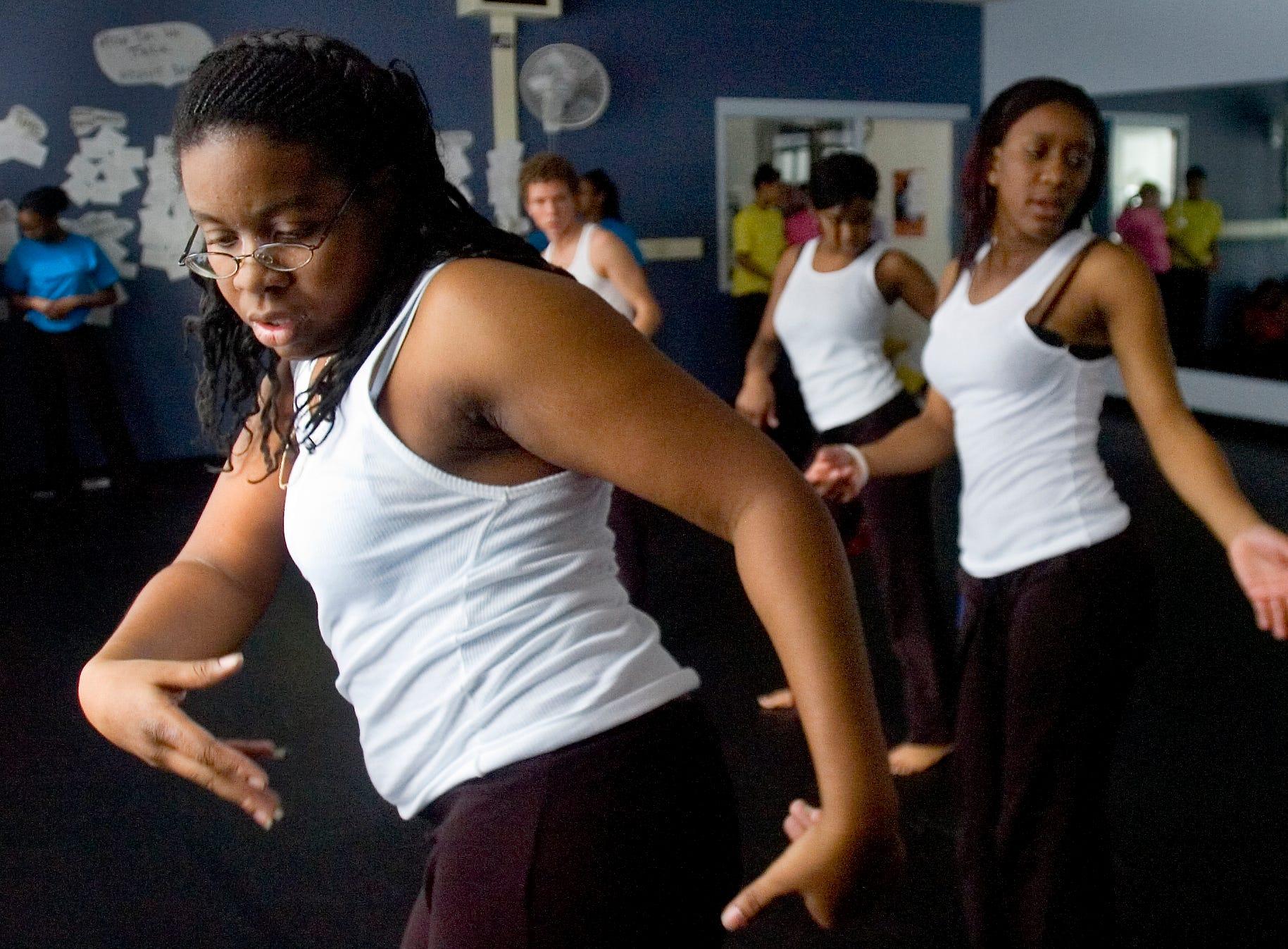 2007: Senior Anika Brabham, left, rehearse for a Binghamton High School Dance Club's performance celebrating Black History Month.
