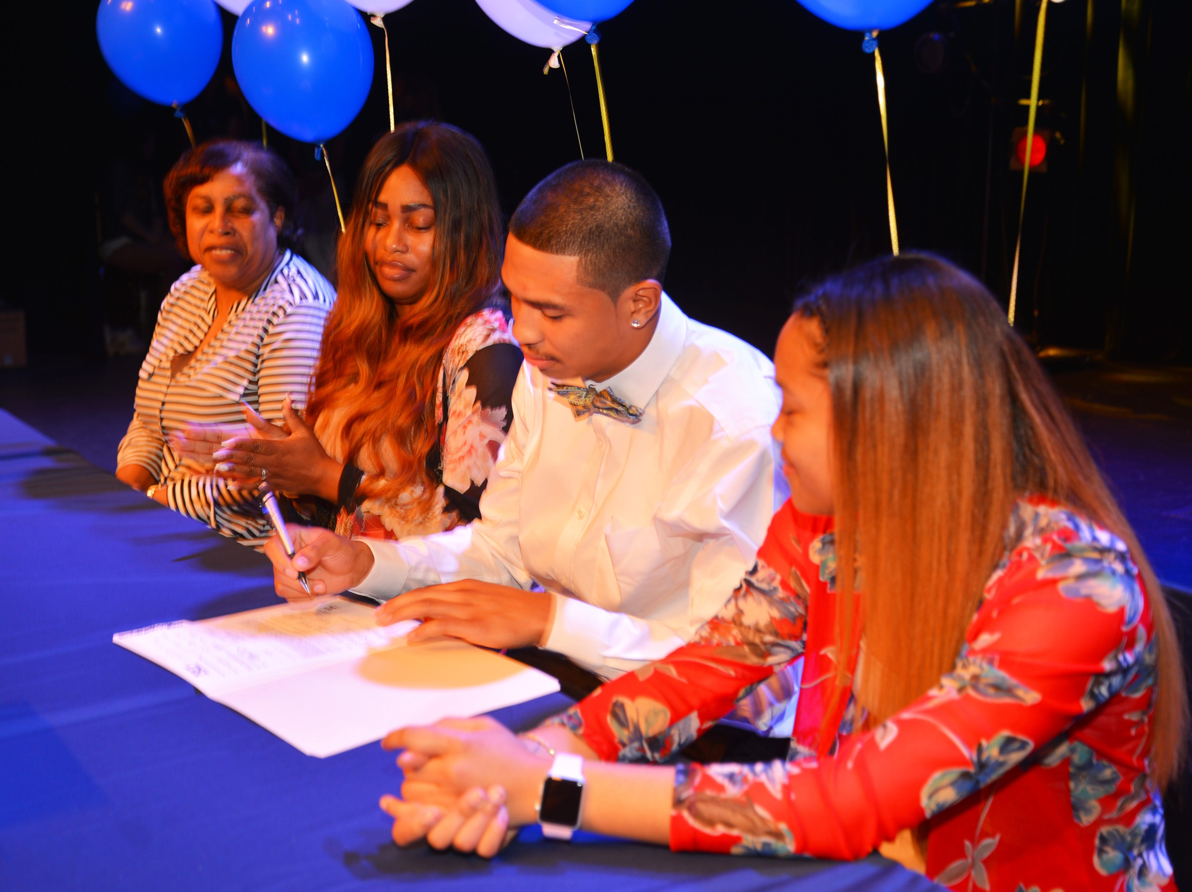 Eau Gallie High School had 11 athletes sign letters of intent on Wednesday. Jaden Gragg with his family.