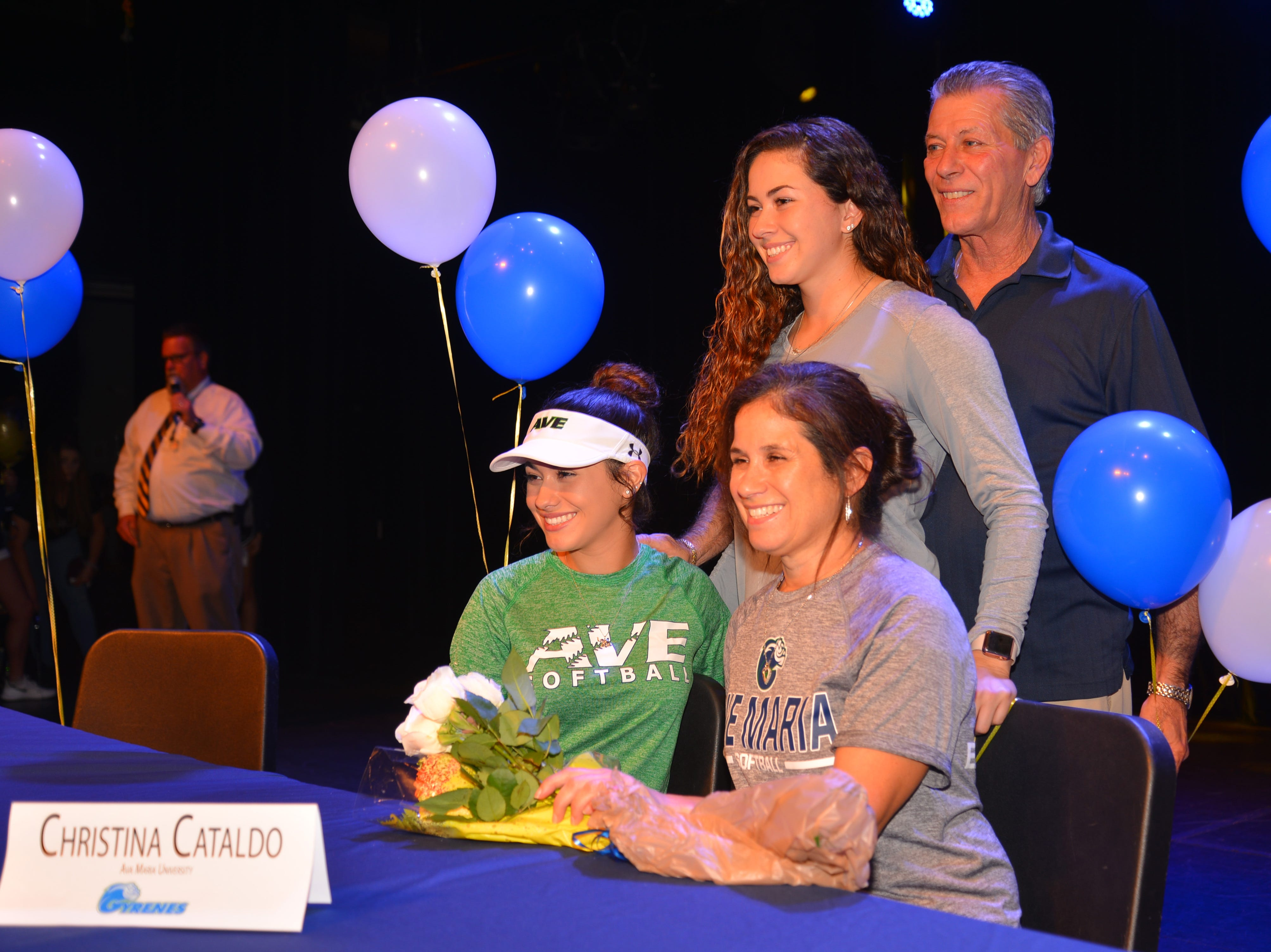 Eau Gallie High School had 11 athletes sign letters of intent on Wednesday. Christina Cataldo poses with her family.