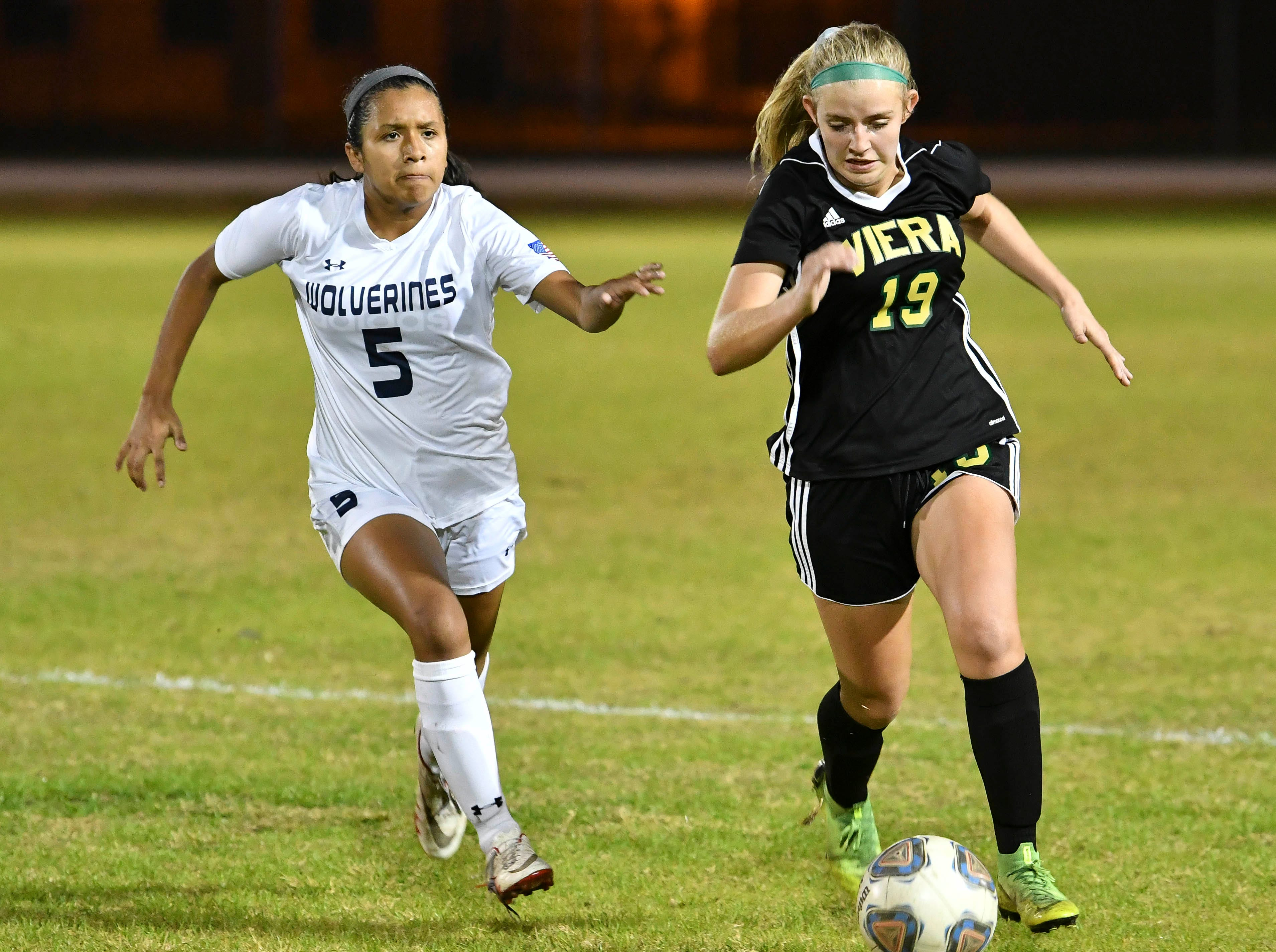 Kristhine Verastegui of Windermere chases Mai Jensen of Viera during Tuesday's Regional Quarterfinal game at Viera High School