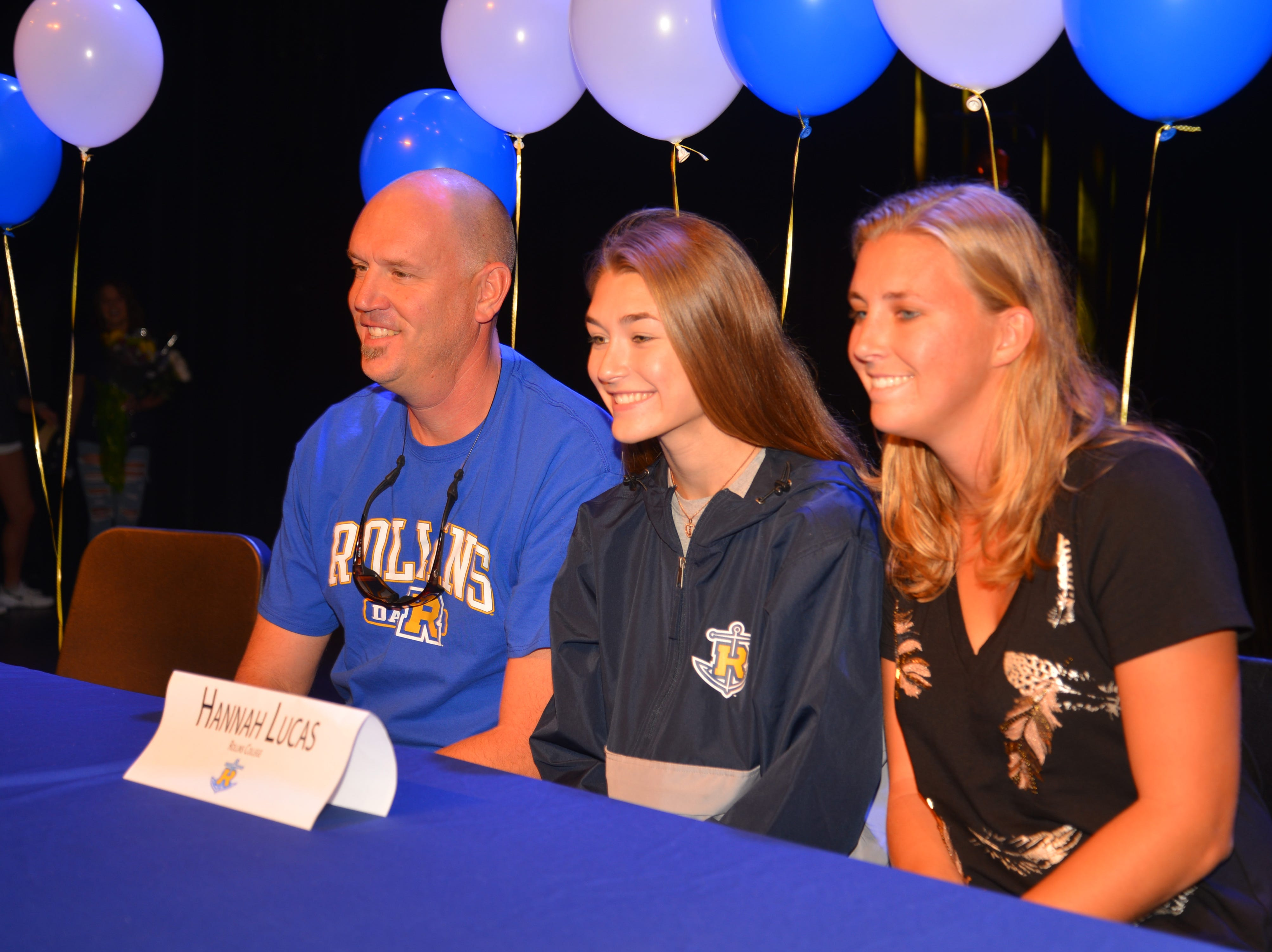Eau Gallie High School had 11 athletes sign letters of intent on Wednesday. Hannah Lucas poses with her family.