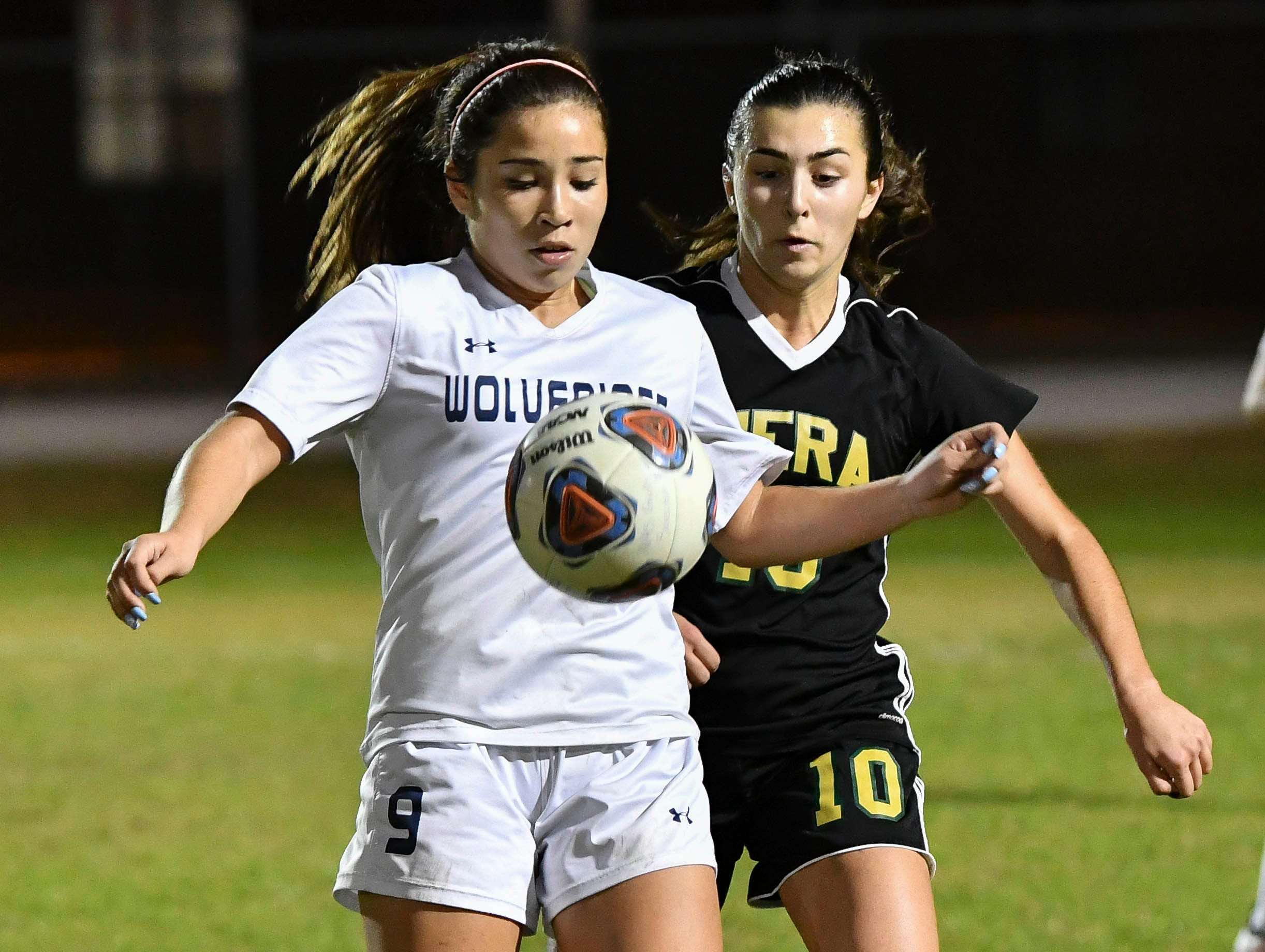 Victoria Gonzales of Windermere is shadowed by Viera's Carolina Santos during Tuesday's Regional Quarterfinal game at Viera High School