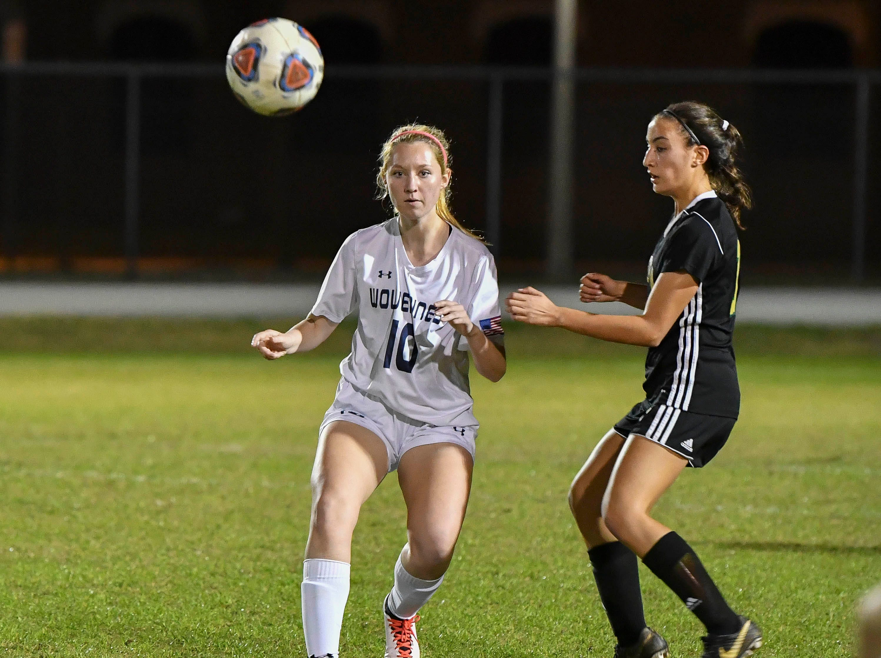 Autumn Lockhart of Windermere drives the ball away from Viera's Serena Zarzana during Tuesday's Regional Quarterfinal game at Viera High School