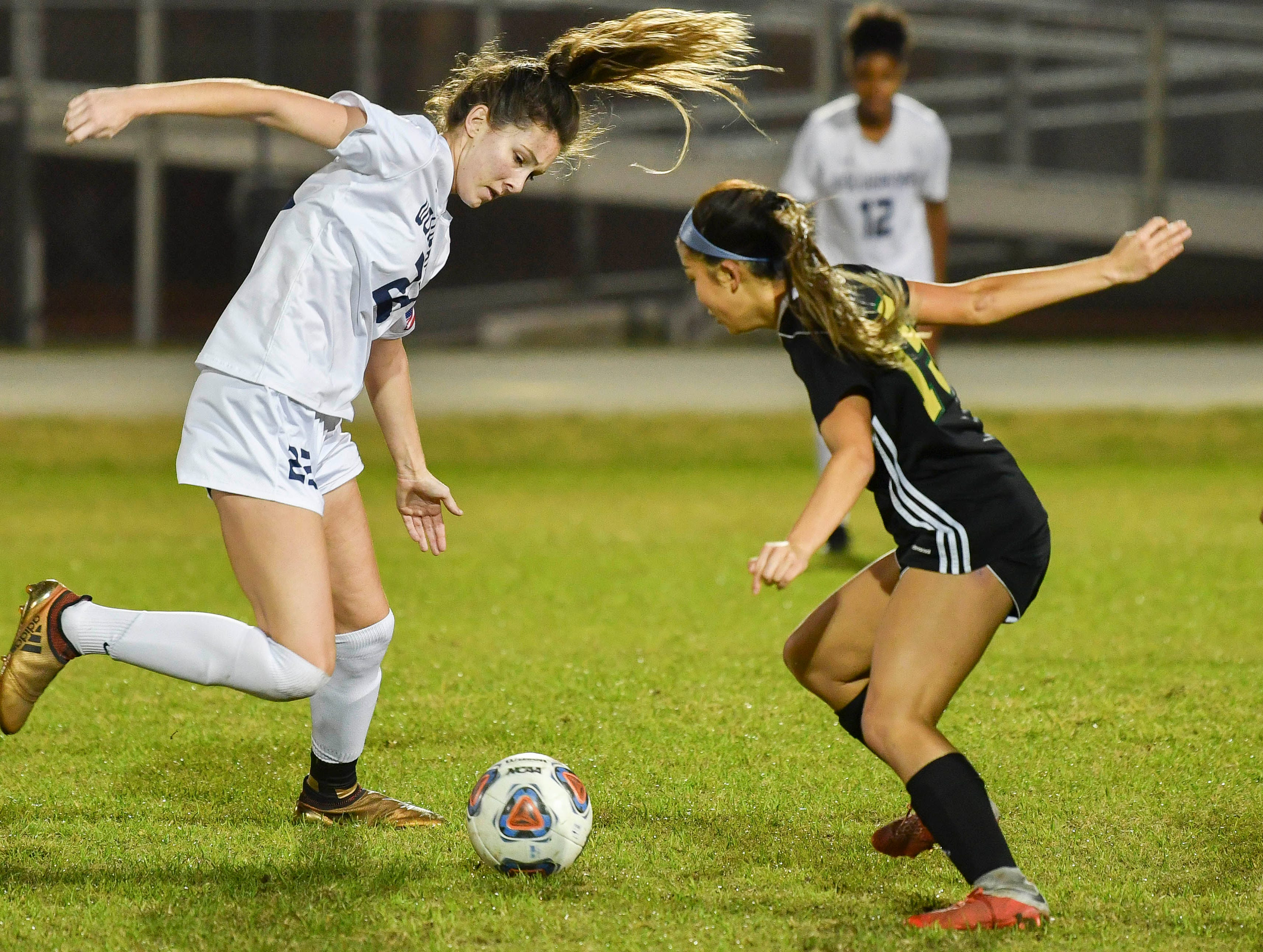Bryce Brozovich of Windermere battles with Viera's Caroline Boston during Tuesday's Regional Quarterfinal game at Viera High School