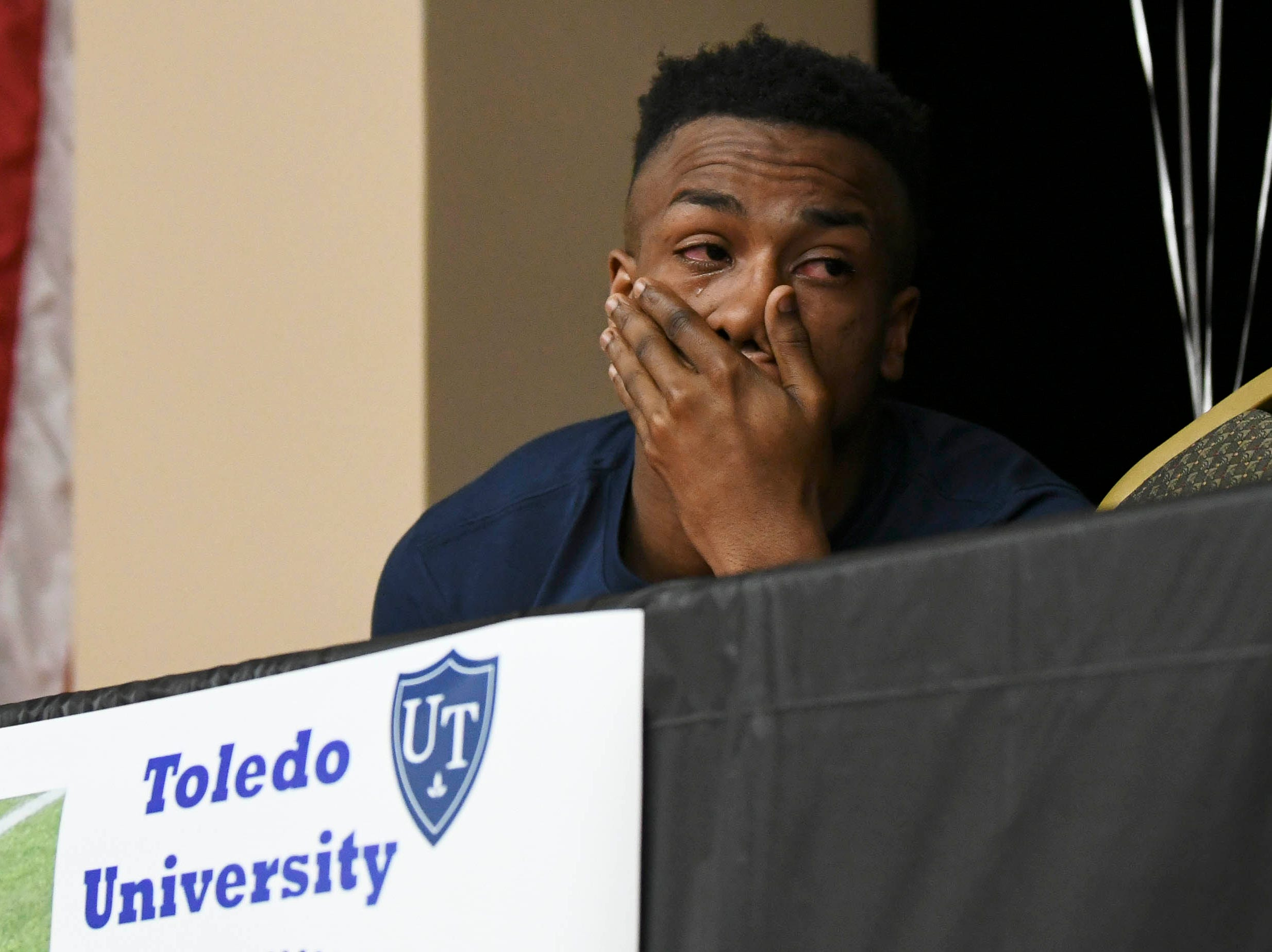 Willie Gaines of Cocoa sheds a tear after signing his letter of intent to attend the University of Toledo on National Signing Day at Cocoa High School.
