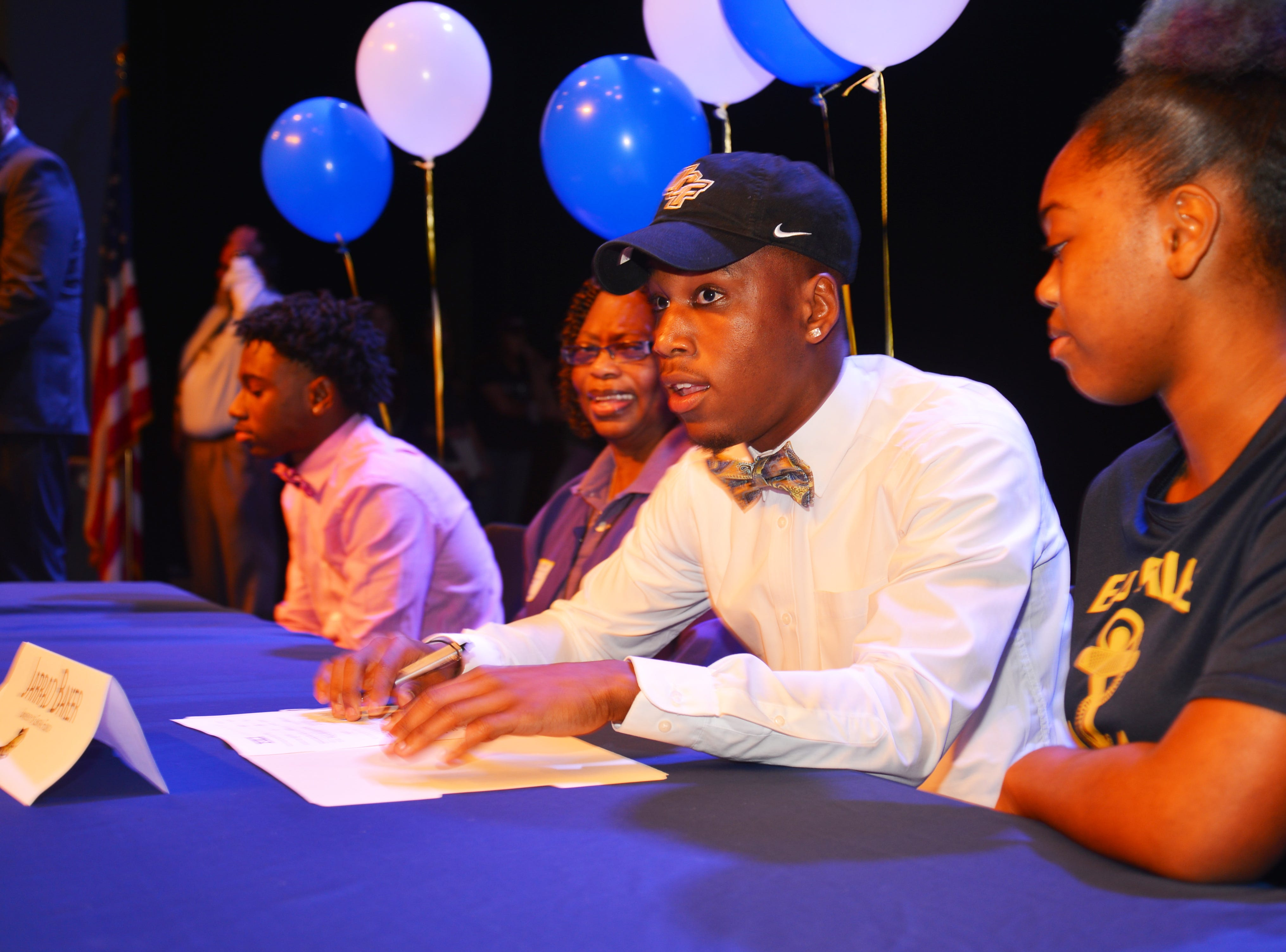 Eau Gallie High School had 11 athletes sign letters of intent on Wednesday. Jarrad Baker at signing day.