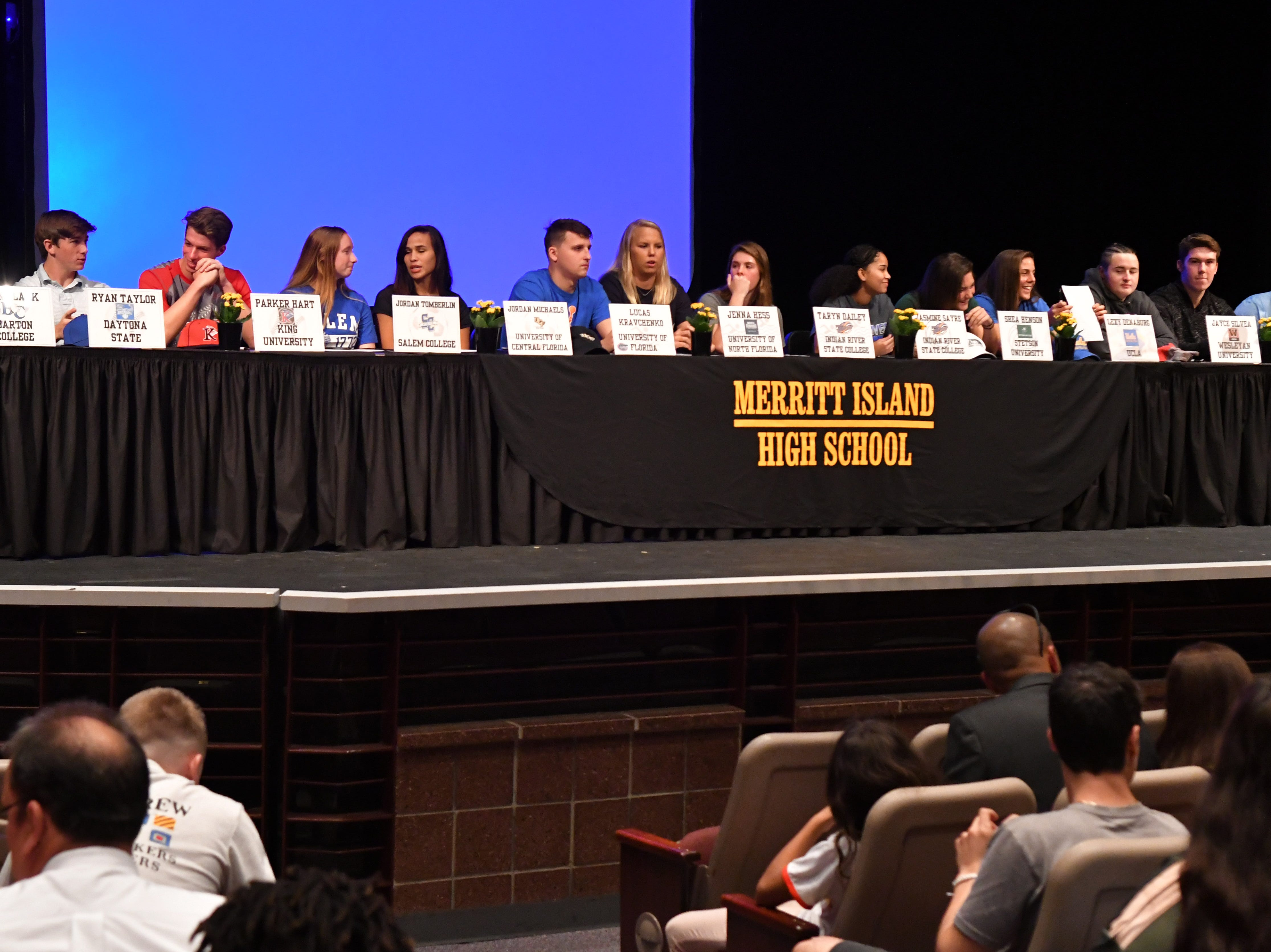 14 athletes from Merritt Island  High School in  signed letters of intent on Wednesday on stage in the school's auditorium.