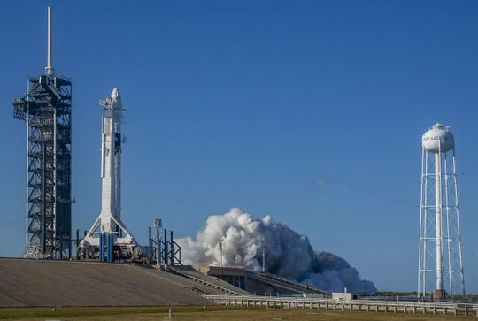 At Kennedy Space Center's Launch Complex 39A, the nine engines of a SpaceX Falcon 9 rocket roared to life in a brief static firing on Jan. 24, 2019. The test was part of checkouts prior to its liftoff for Demo-1, the inaugural flight of one of the commercial spacecraft designed to take NASA astronauts to and from the International Space Station.