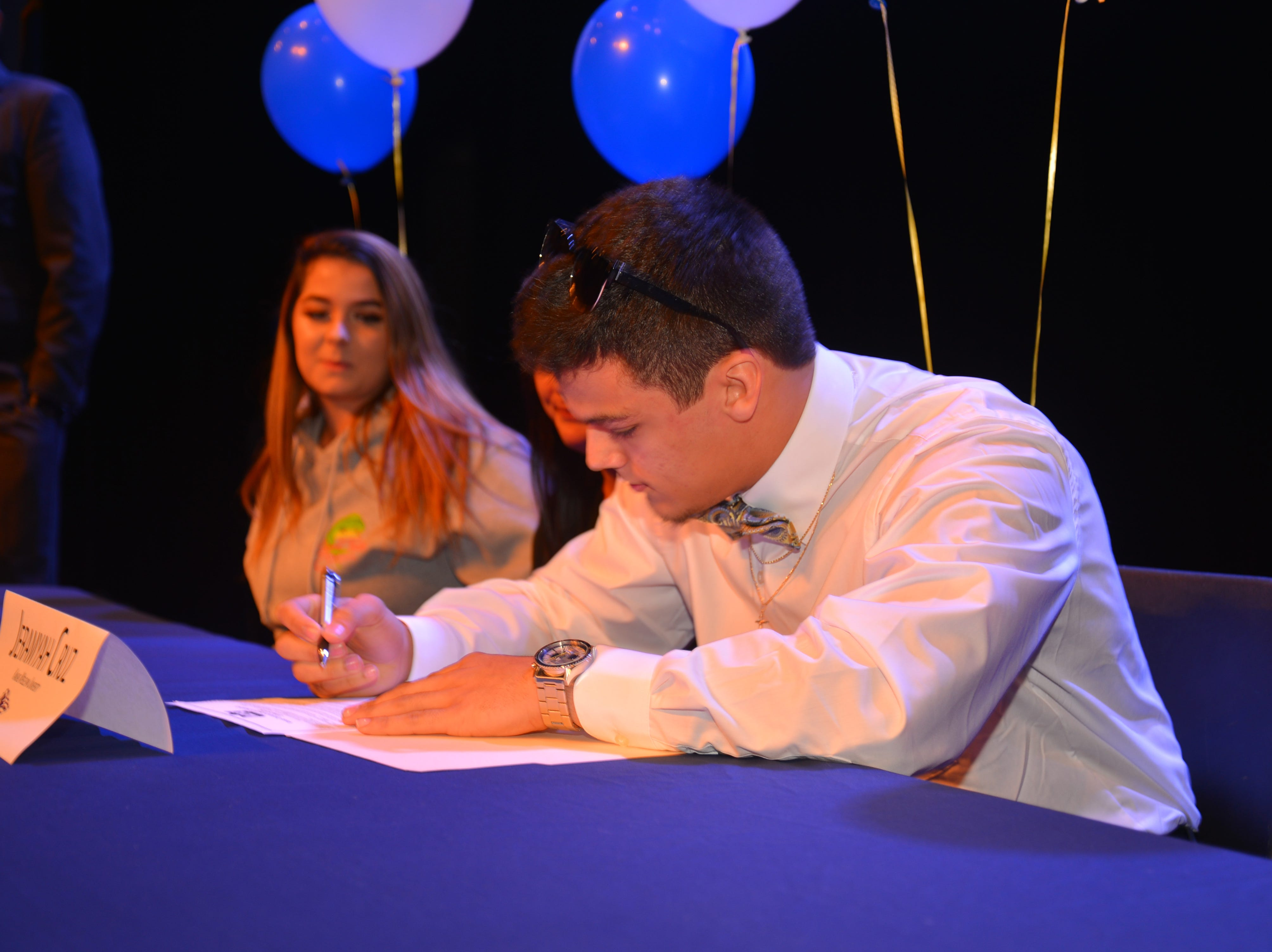 Eau Gallie High School had 11 athletes sign letters of intent on Wednesday. Jeramyah Cruz signs.