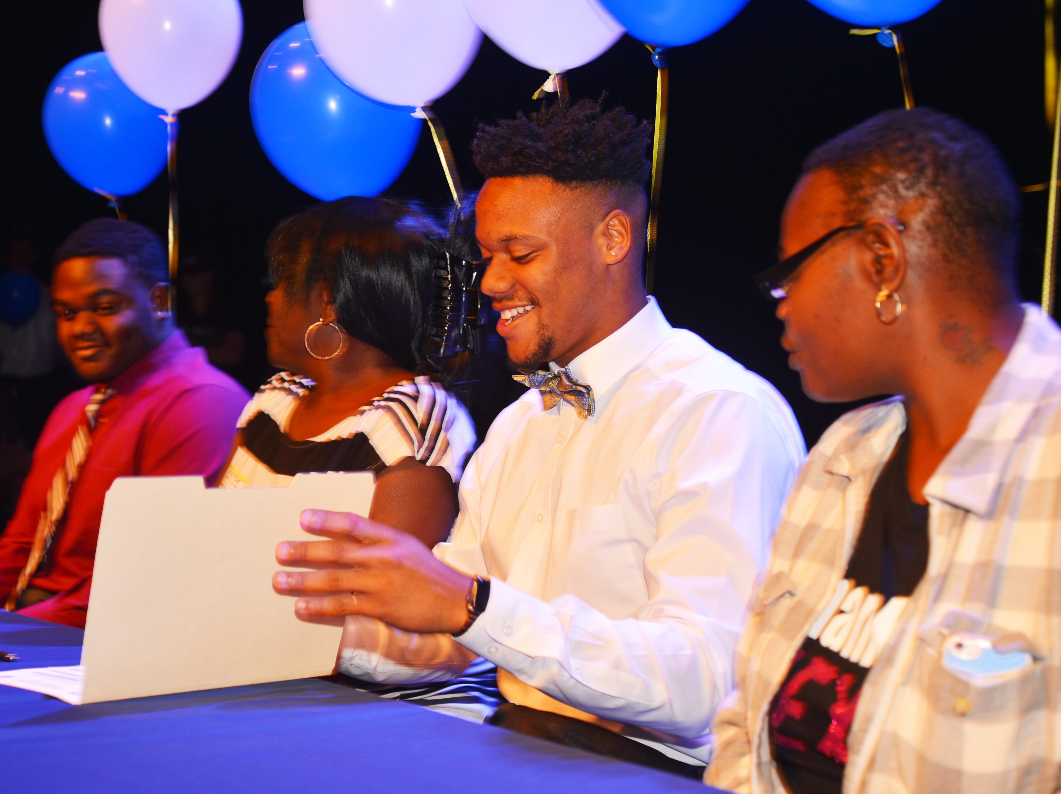 Eau Gallie High School had 11 athletes sign letters of intent on Wednesday. Zachary Passion geting ready to sign.