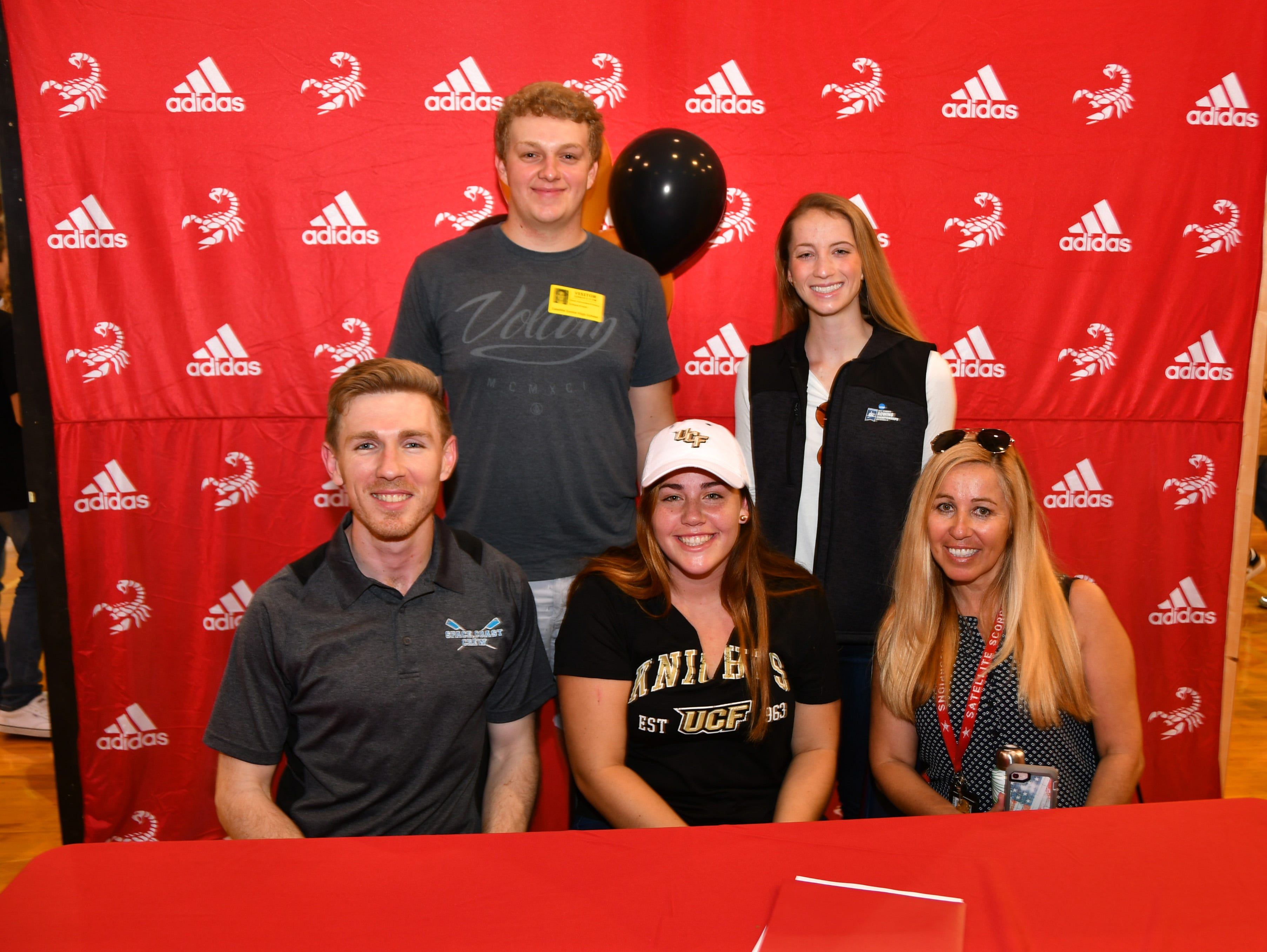 Satellite Had seven students sign letters of intent on Wednesday. Karly Smith with her family.
