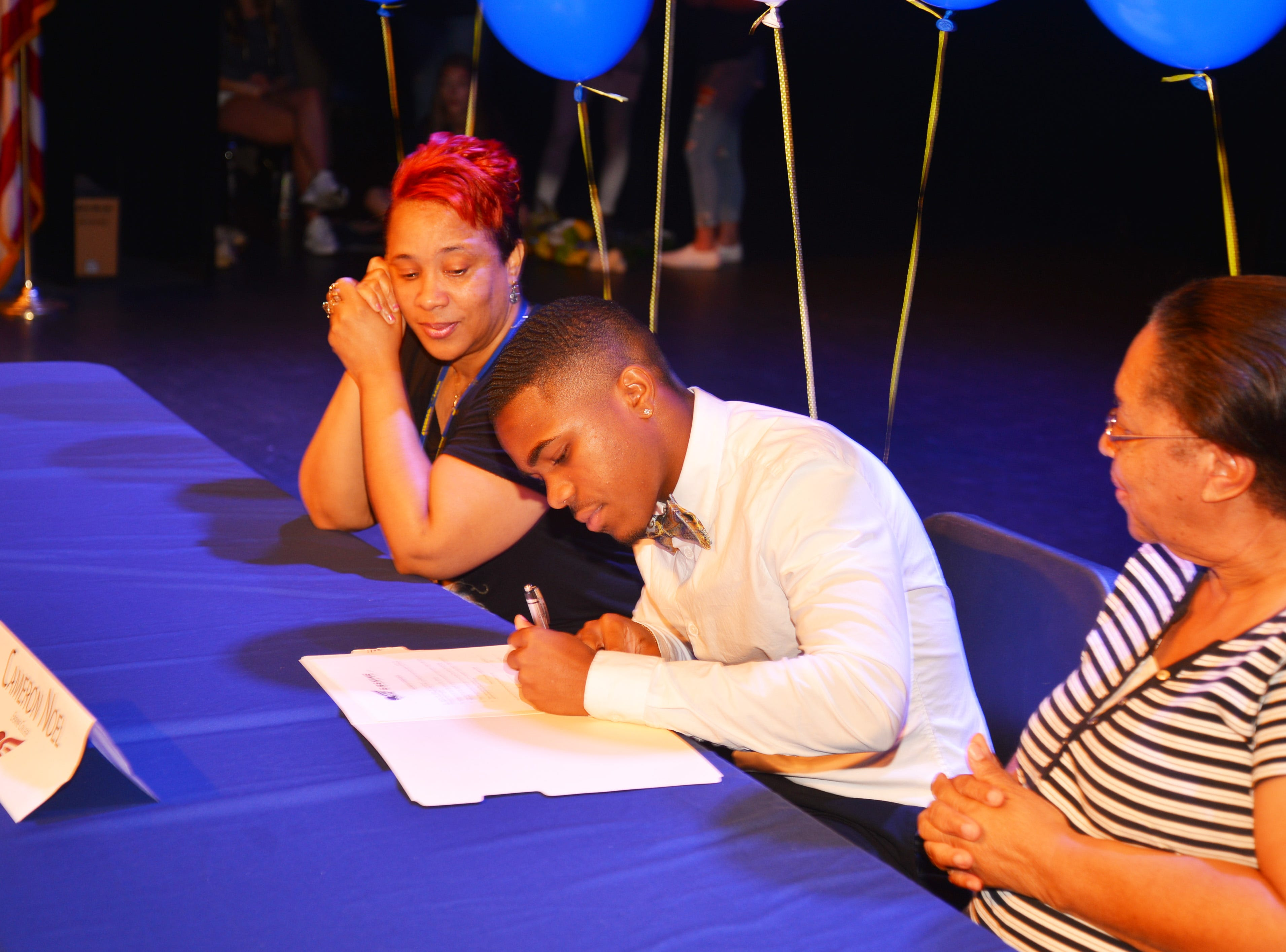Eau Gallie High School had 11 athletes sign letters of intent on Wednesday. Cameron Noel signs.