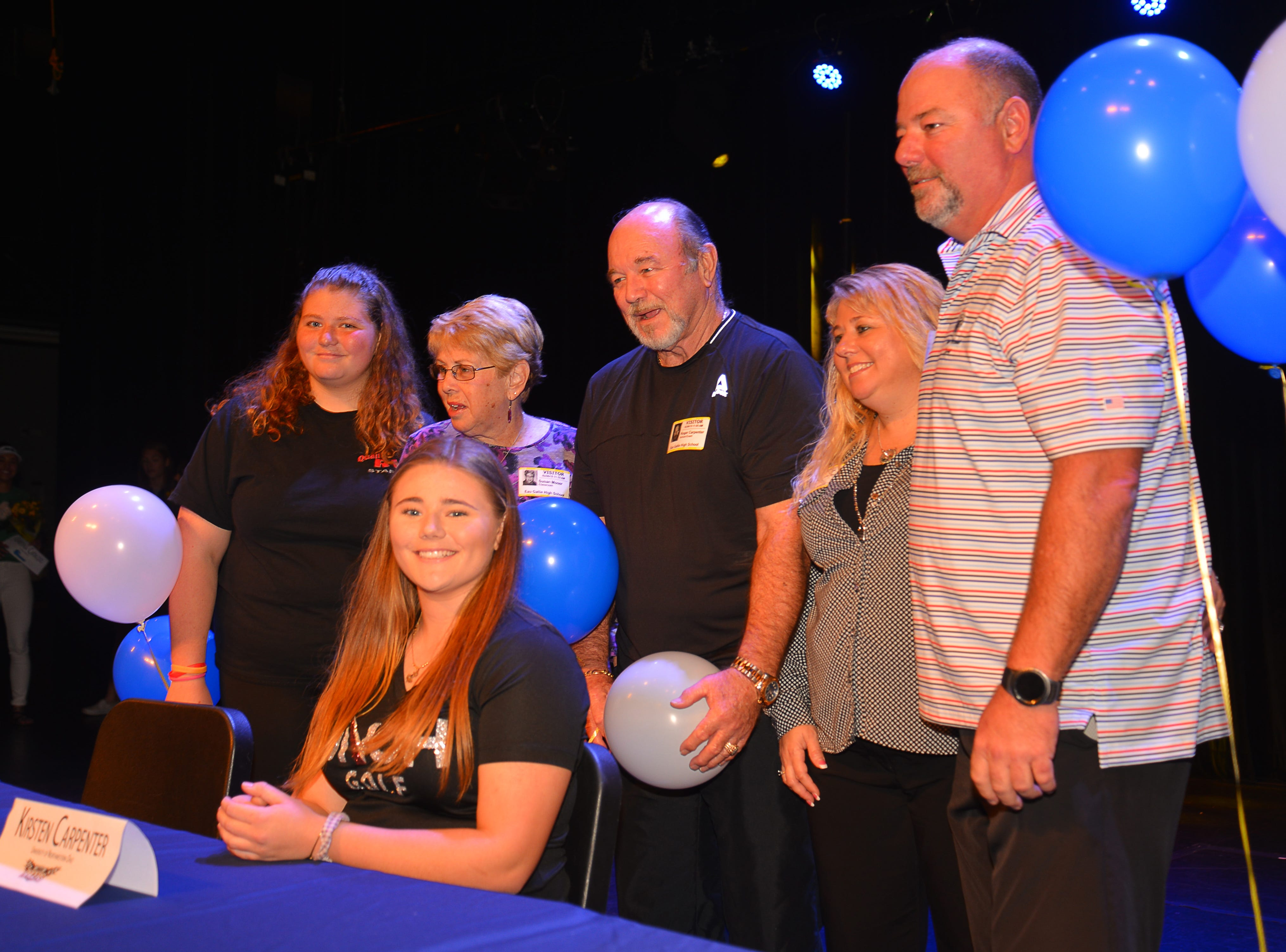 Eau Gallie High School had 11 athletes sign letters of intent on Wednesday. Kristen Carpenter poses with her family.