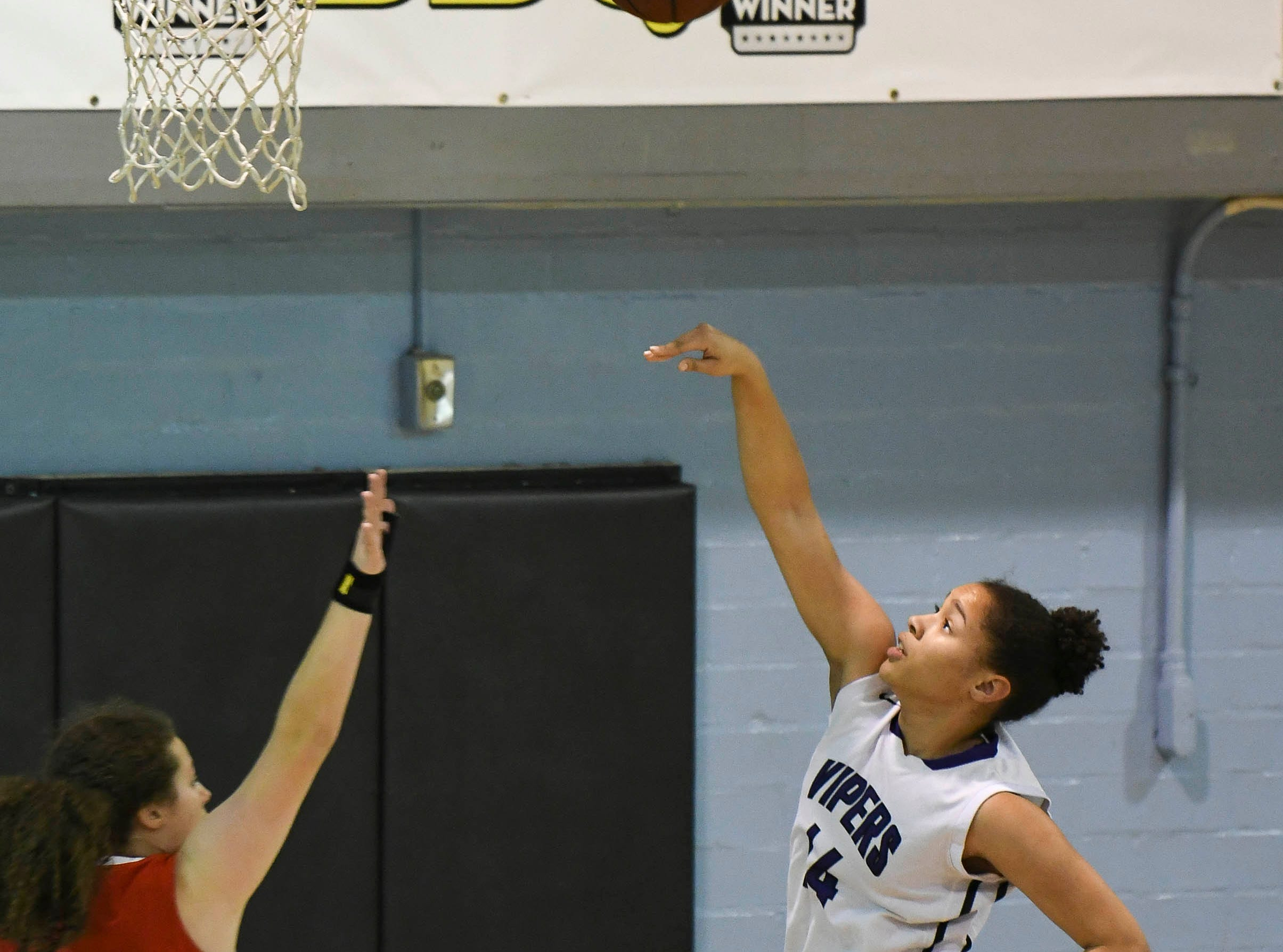 Brianna Bradley of Space Coast takes a shot during Tuesday's district tournament game at Rockledge High