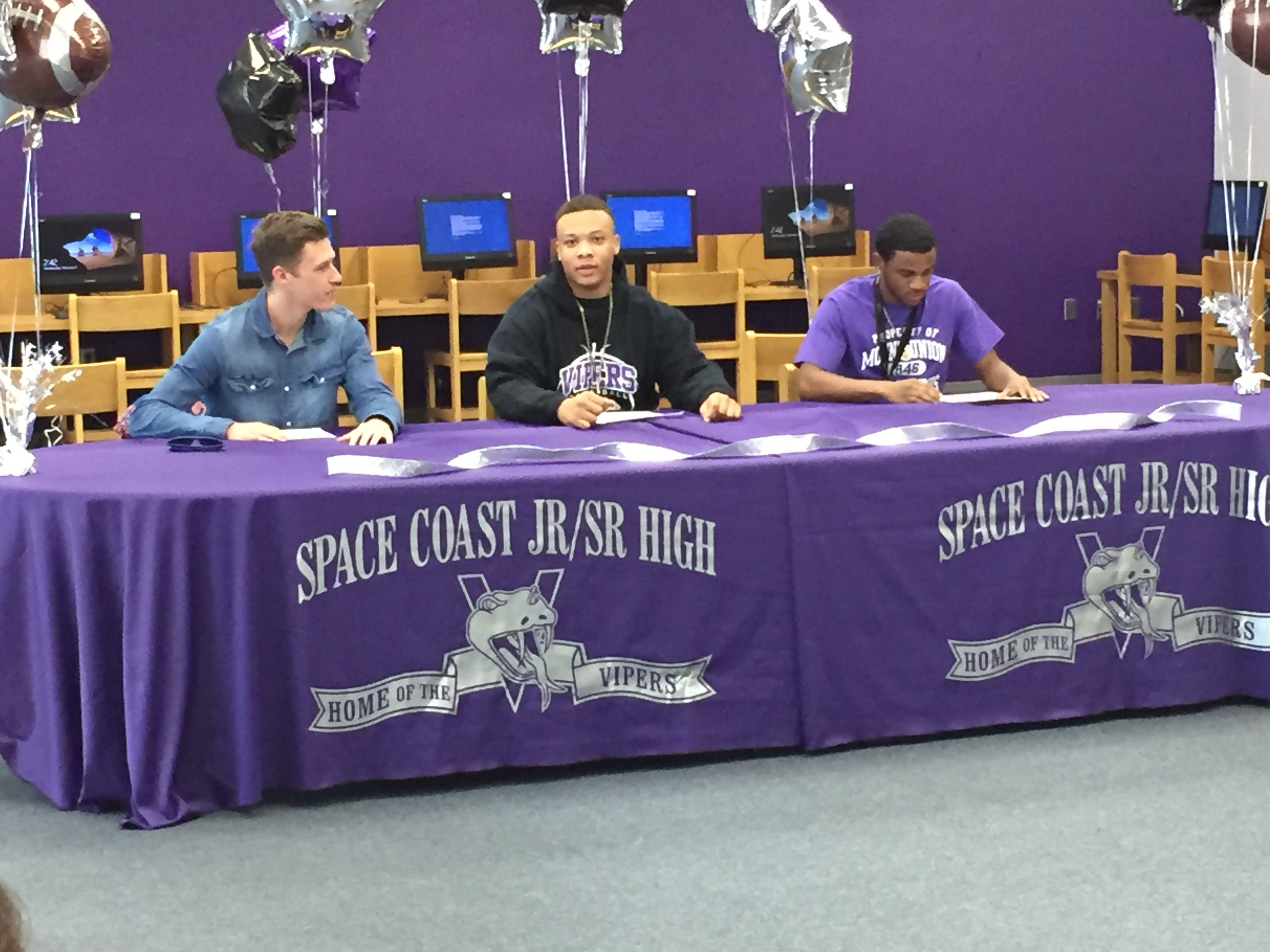 National Signing Day at Space Coast for (left to right) Michael Barton, T.Jay Mitchell and Devontae Shingles.