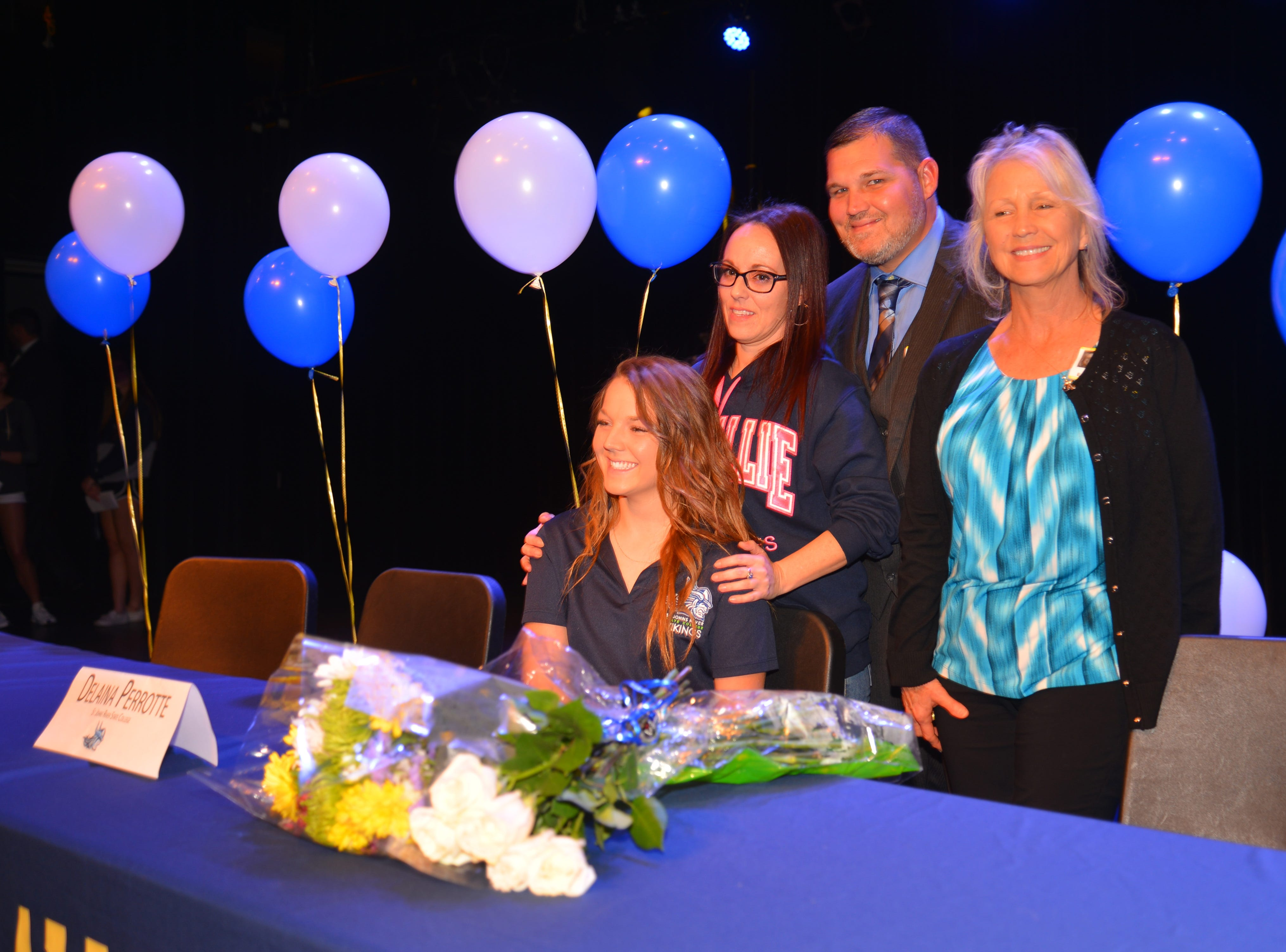 Eau Gallie High School had 11 athletes sign letters of intent on Wednesday. Deanna Perrotte poses with her family.