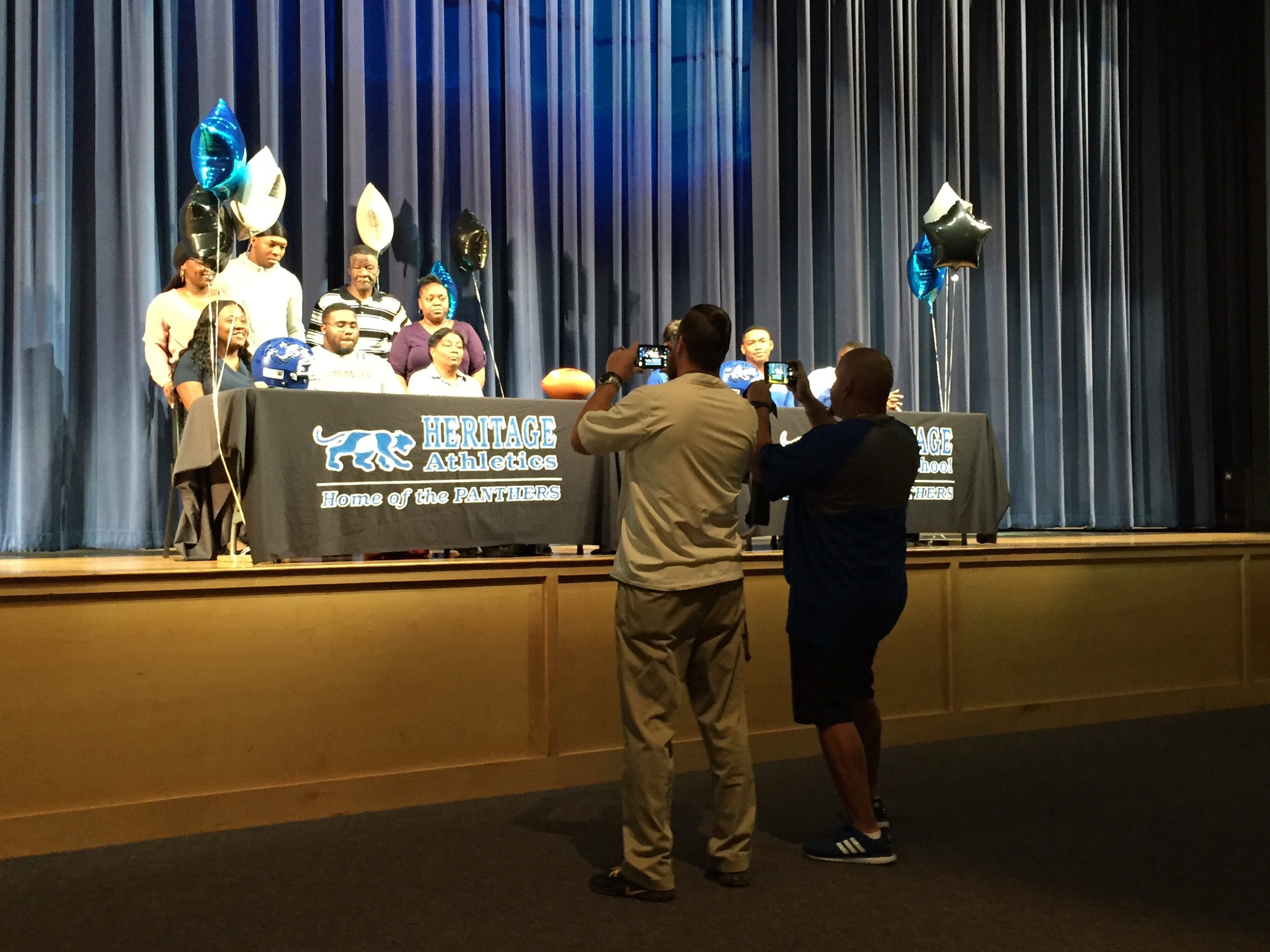 Signees pose for photos with family at Heritage on National Signing Day.