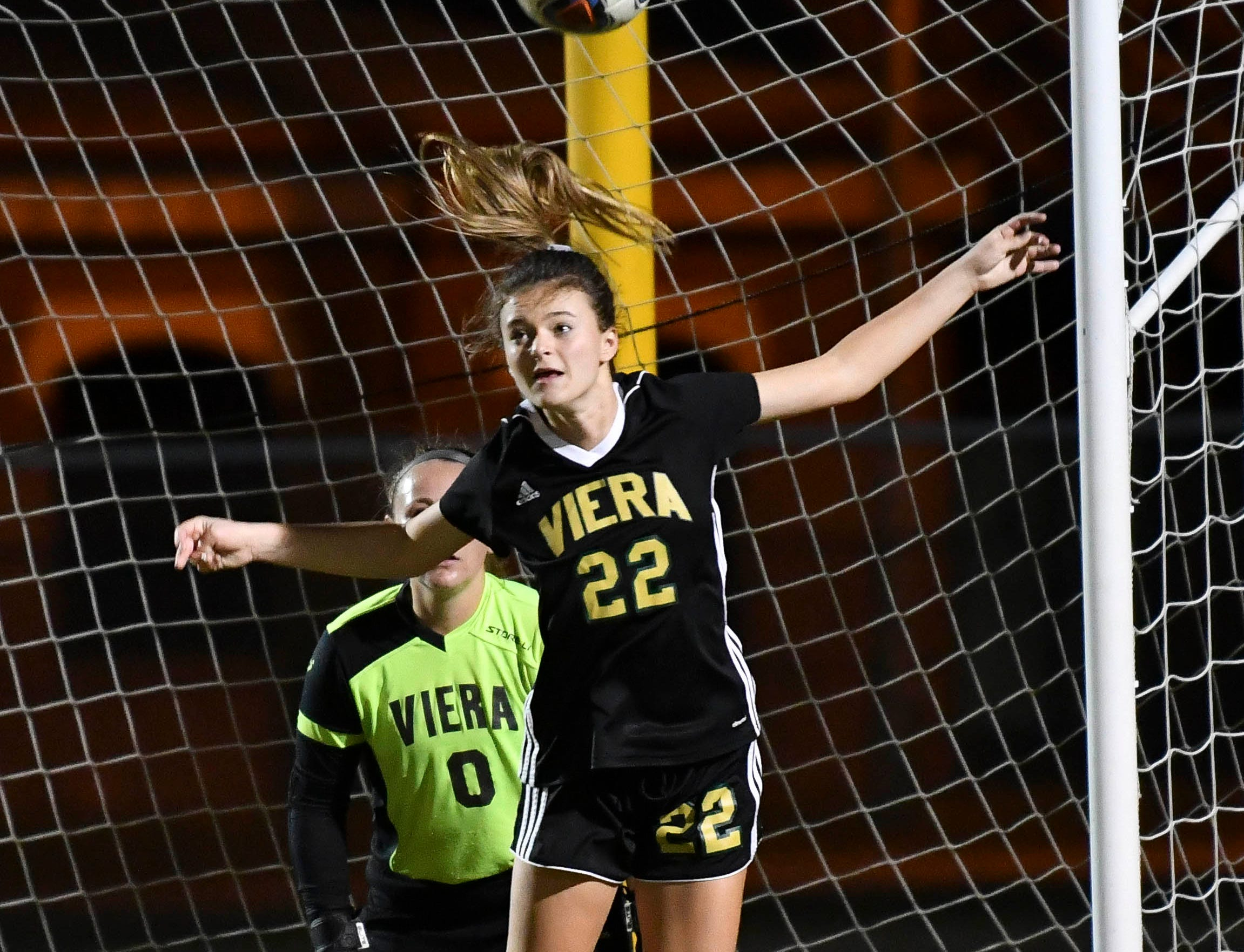 Lauren Mieczkowski of Viera heads the ball away from the Hawks goal during Tuesday's Regional Quarterfinal game at Viera High School