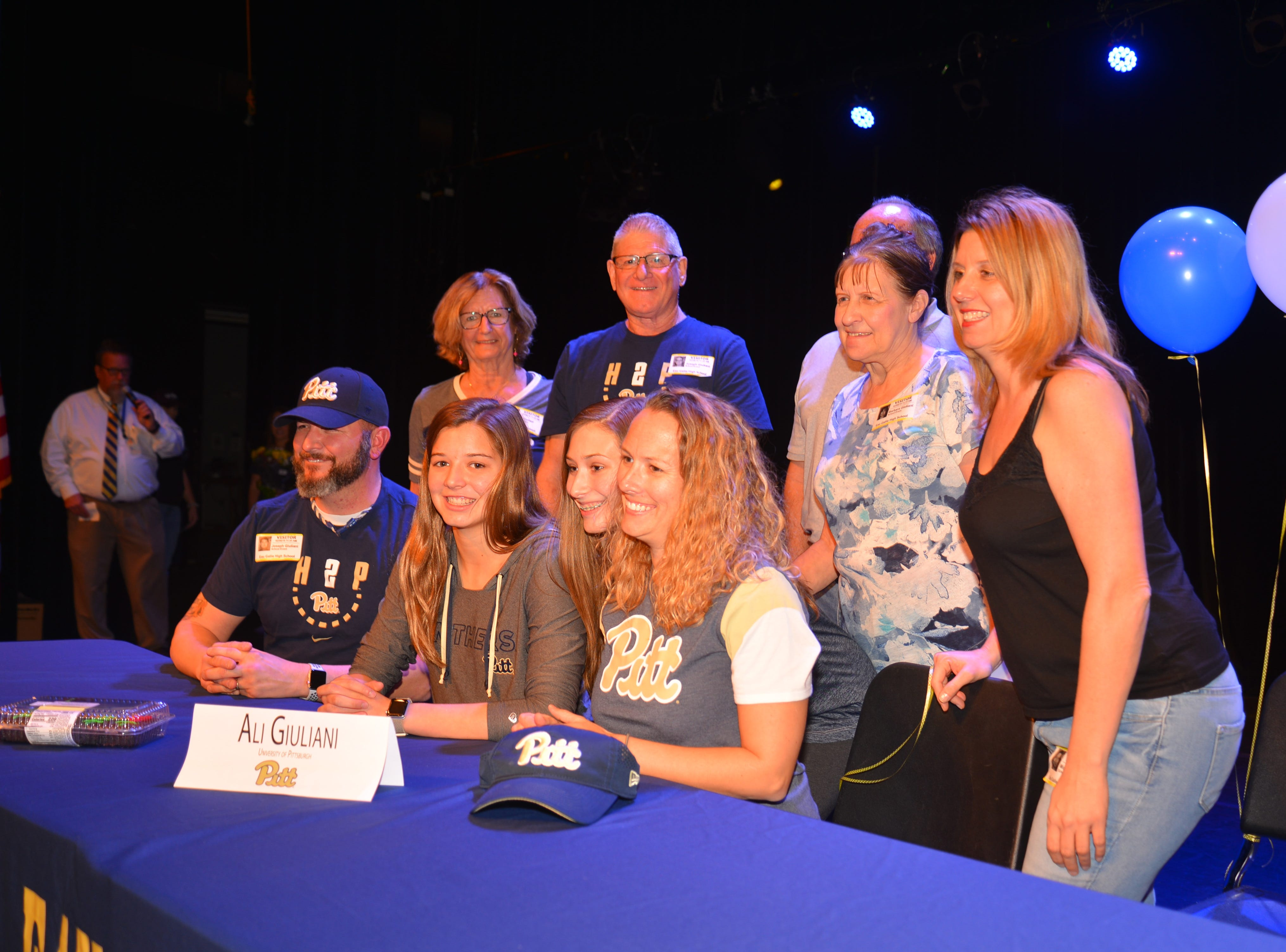 Eau Gallie High School had 11 athletes sign letters of intent on Wednesday. Ali Giuyliani poses with her family.