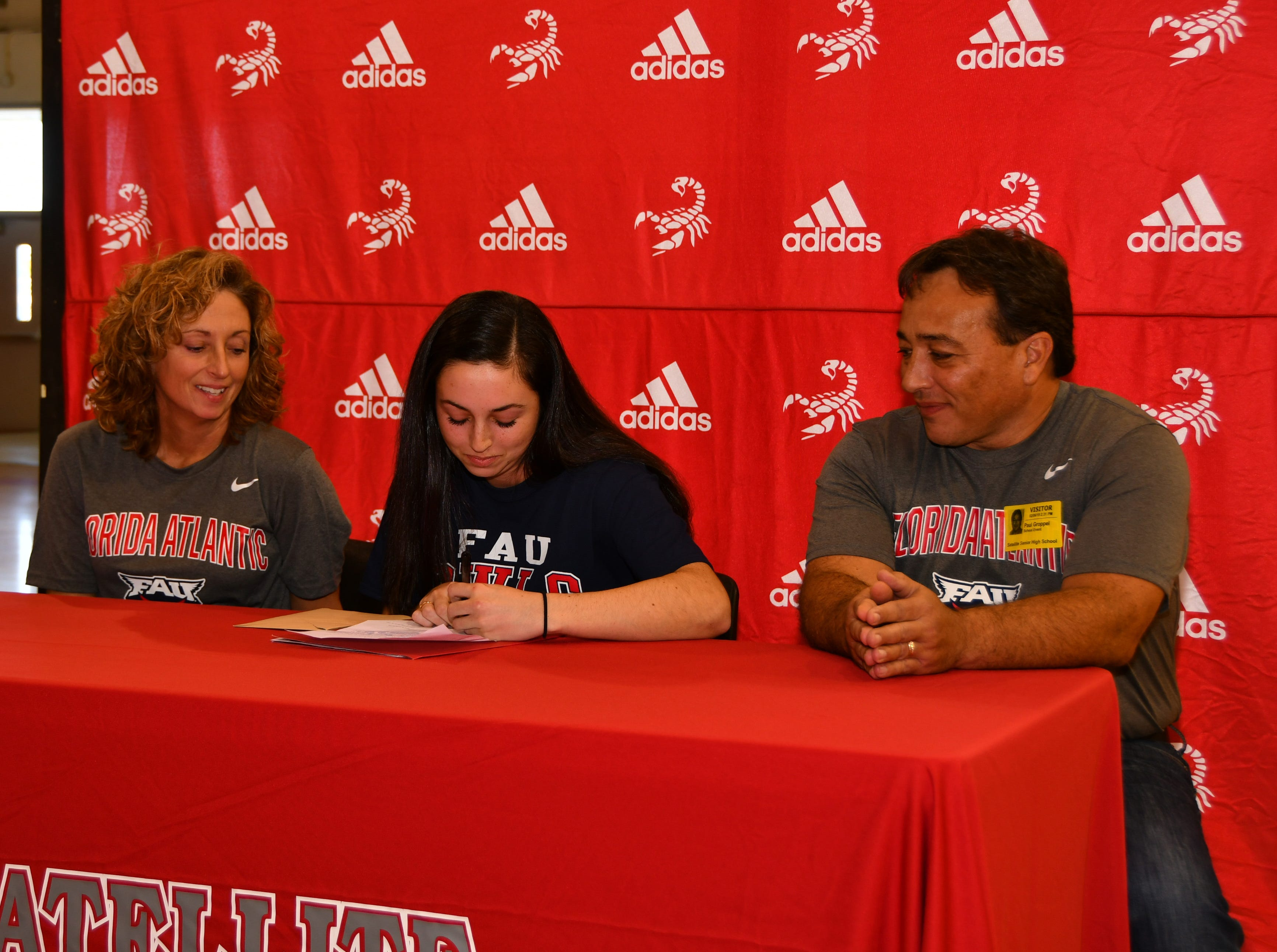 Satellite Had seven students sign letters of intent on Wednesday. Marie Groppel signs her letter.
