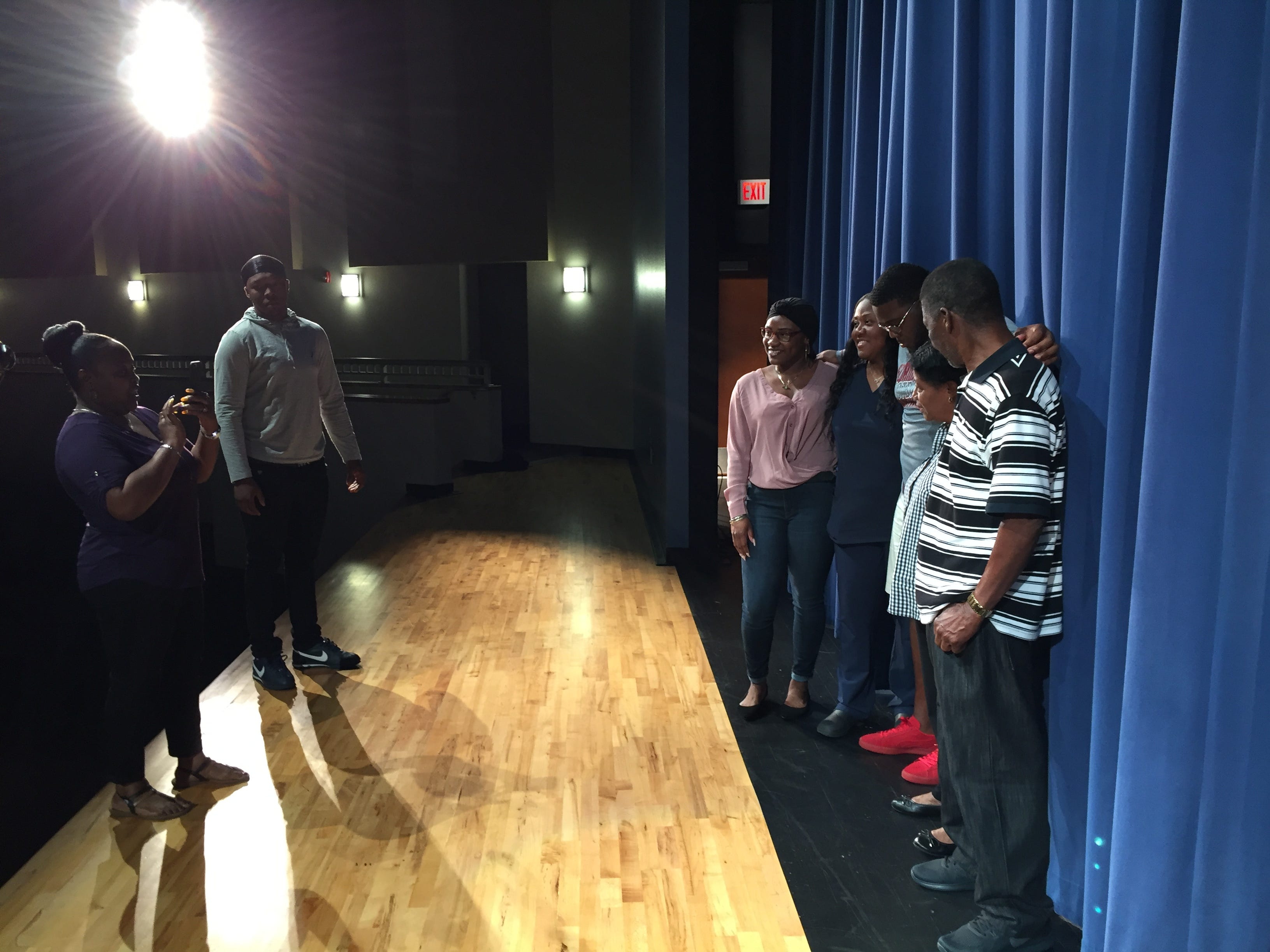 Photos are a major part of National Signing Day, as seen at Heritage High.