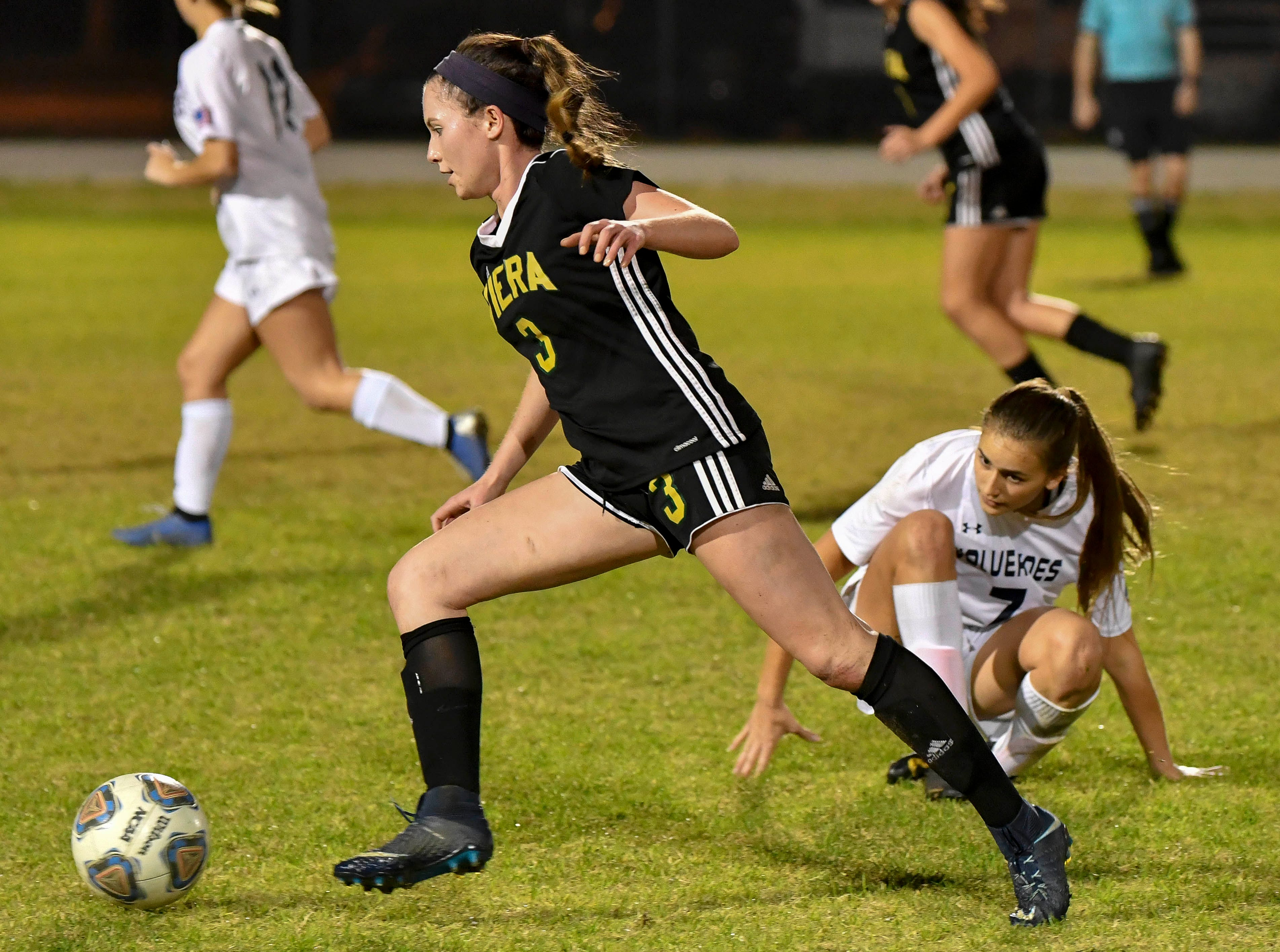 Taylor Collins of Viera drives around Miya Skretteberg of Windermere during Tuesday's Regional Quarterfinal game at Viera High School