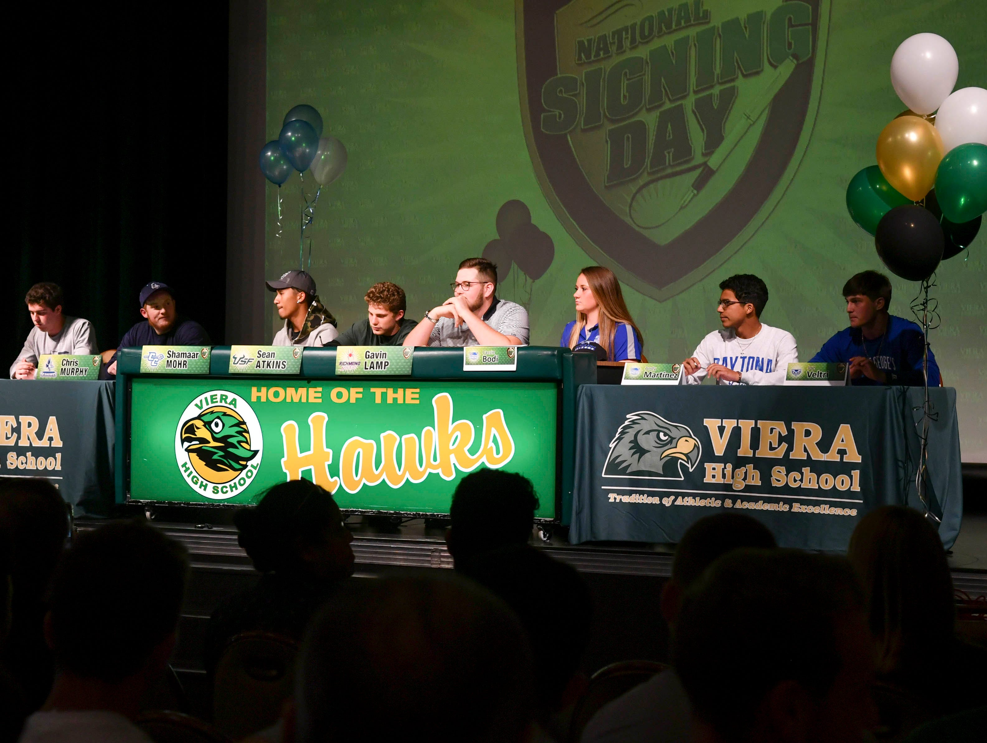 Viera High students sign their leter of intent Wednesday during National Signing Day at the school.