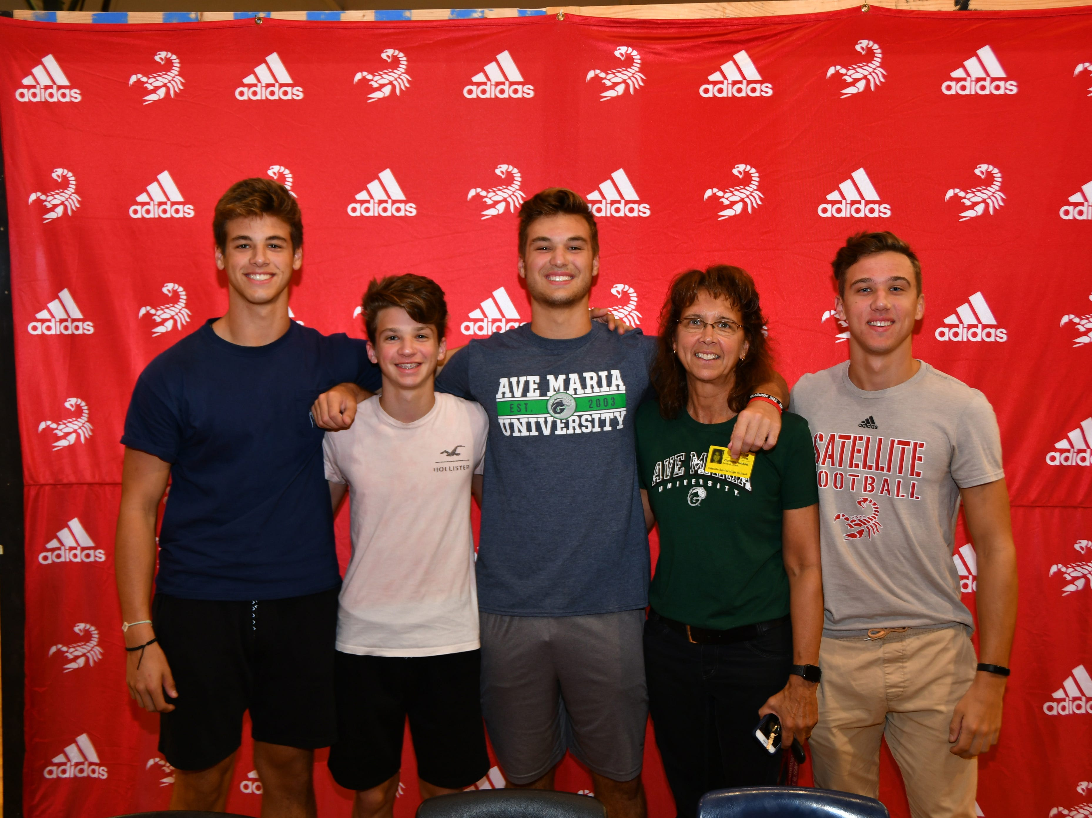Satellite Had seven students sign letters of intent on Wednesday. Jackson Hinkell with his family.