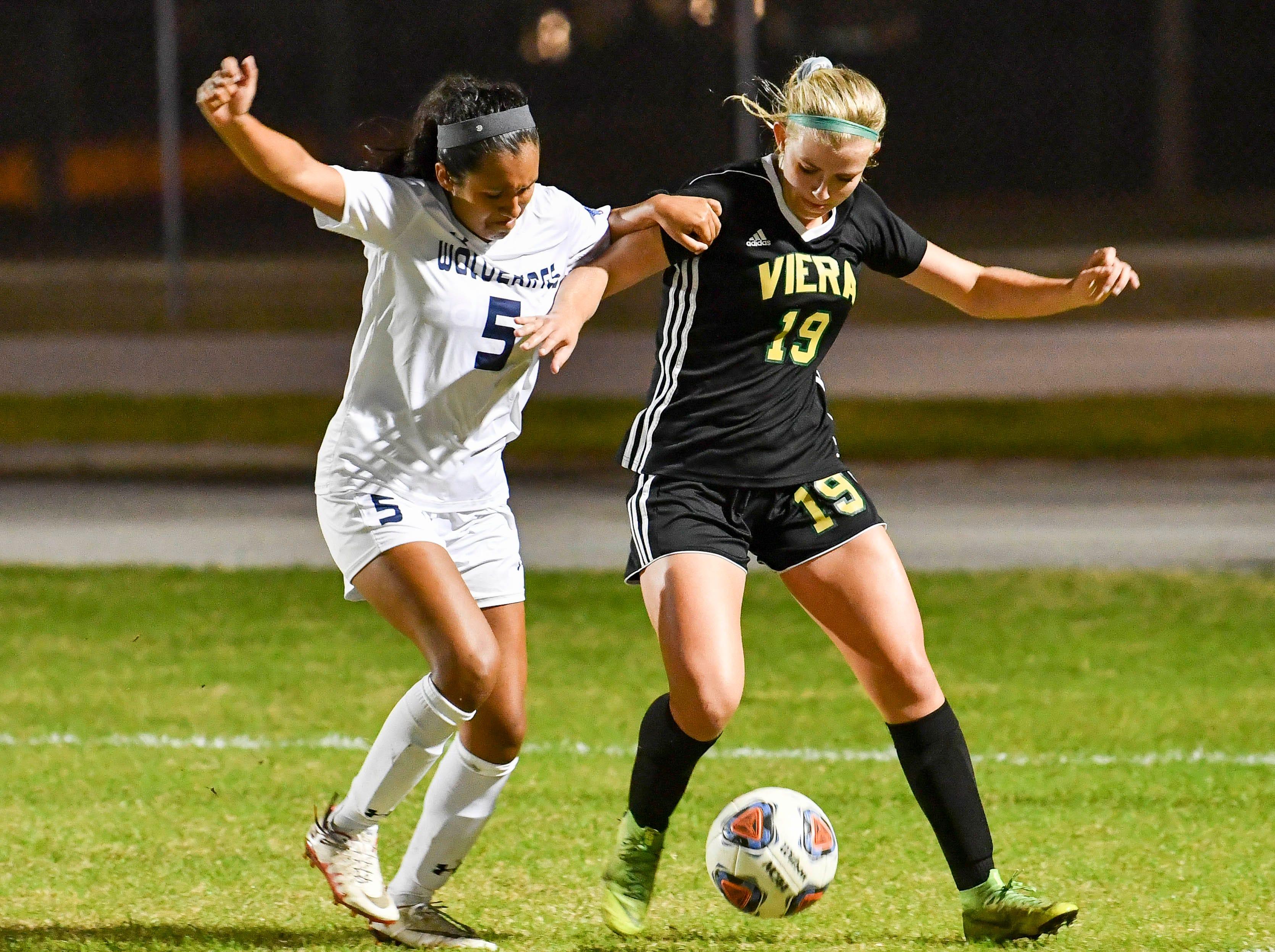 Kristhine Verastegui of Windermere battles with Mai Jensen of Viera during Tuesday's Regional Quarterfinal game at Viera High School