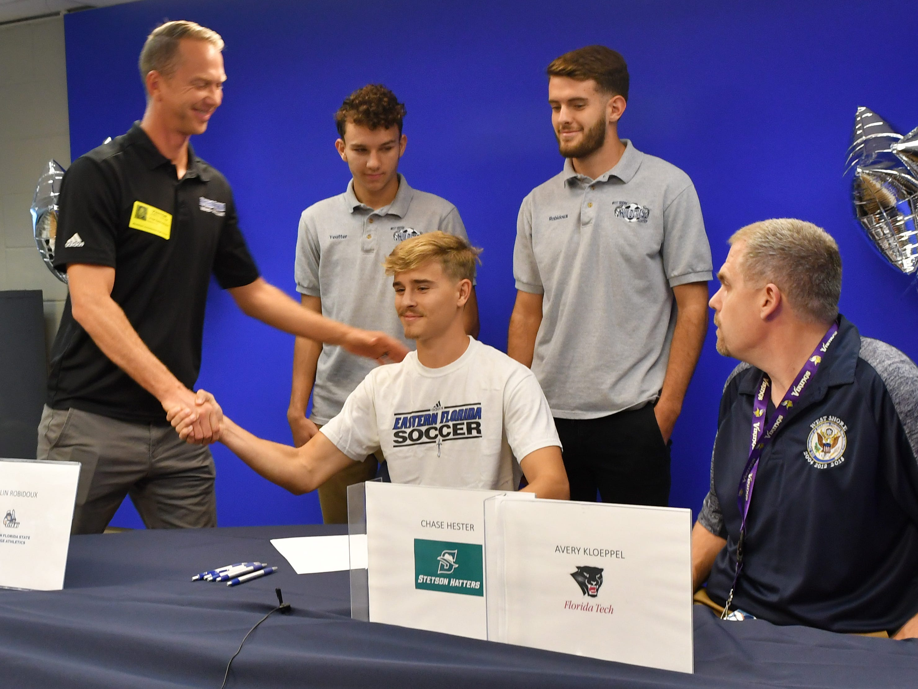 Ian Leighton signs with Eastern Florida State College. Five soccer athletes from West Shore Junior/Senior High School in Melbourne signed letters of intent on Wednesday.