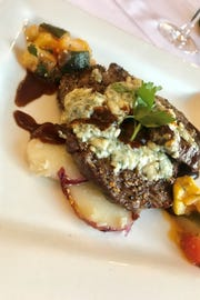 Beef tenderloin topped with blue cheese in port wine sauce is one of the entrees on the menu at Continental Flambe in downtown Melbourne.