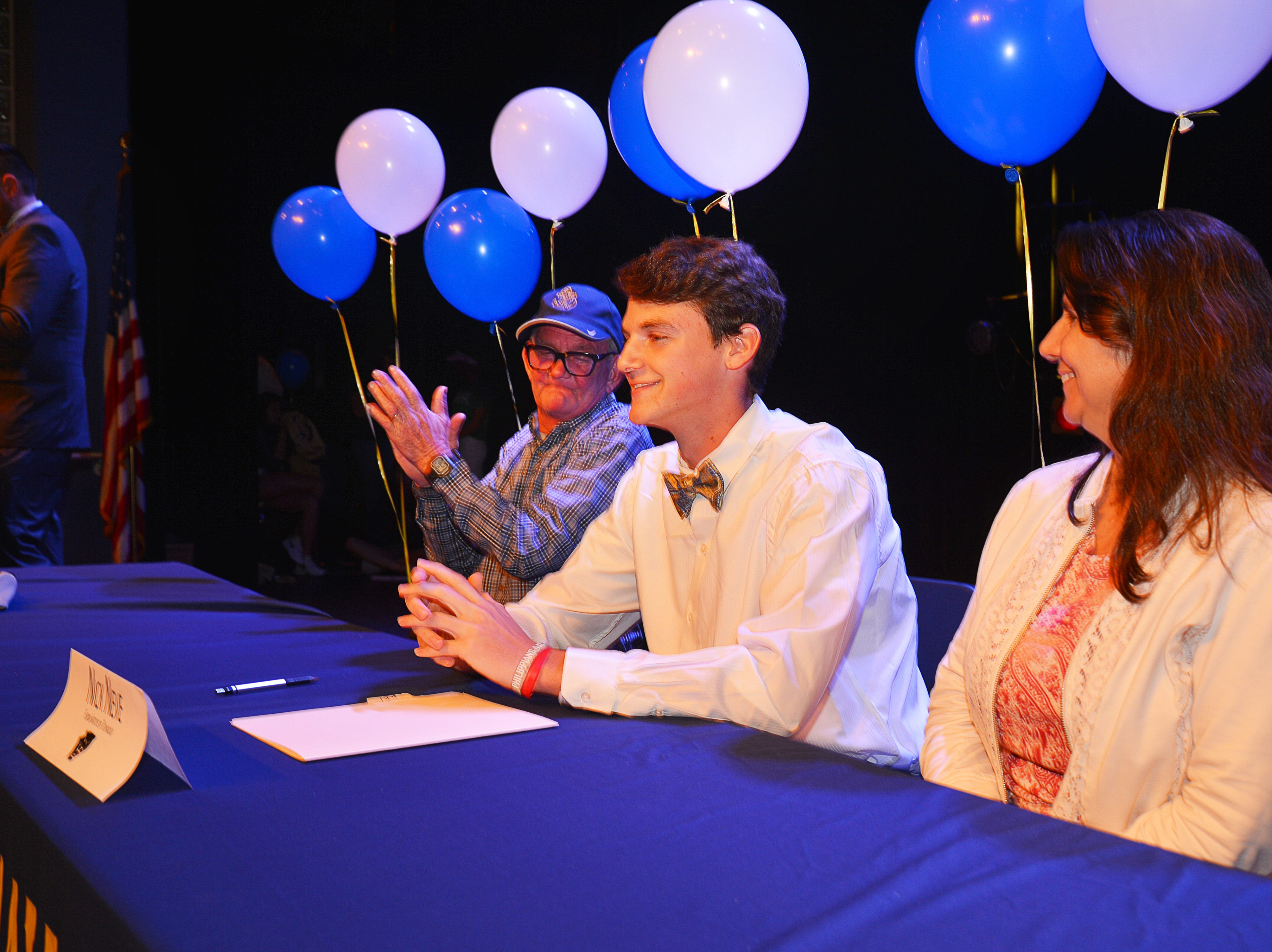 Eau Gallie High School had 11 athletes sign letters of intent on Wednesday. Nick Neve with his family.
