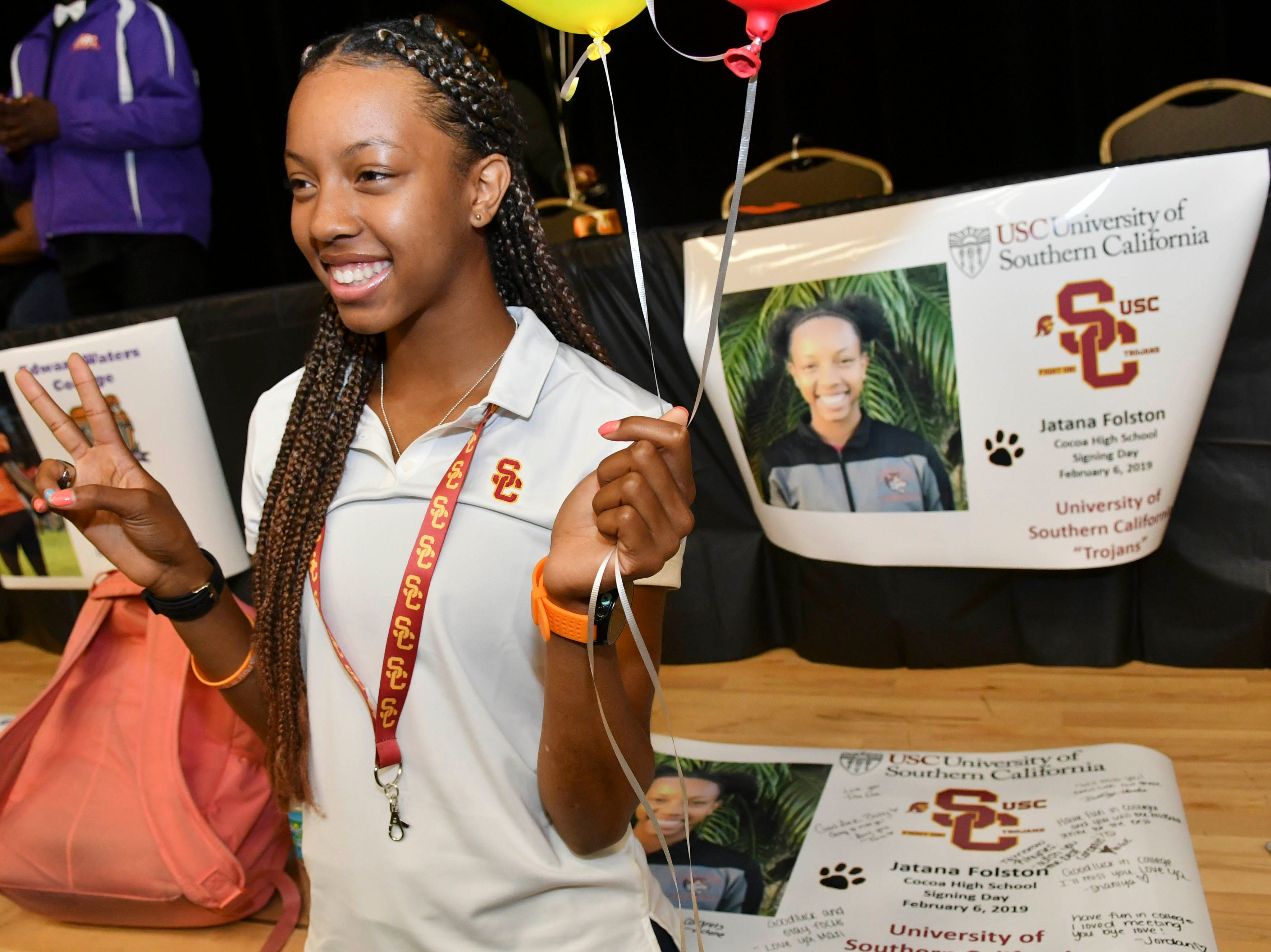 Jatana Folston of Cocoa High poses for pictures after signing a letter of intent to the University of Southern California during National Signing Day at Cocoa High School