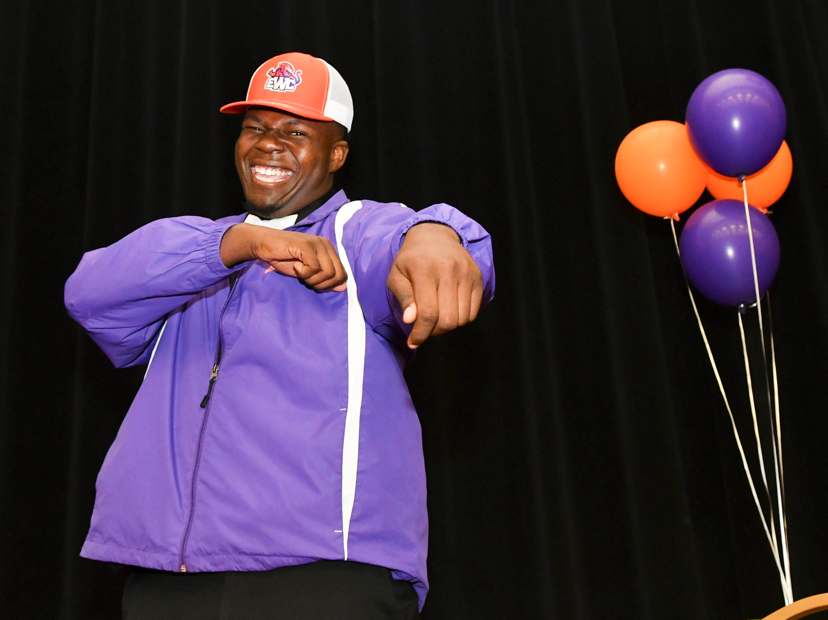 Nicolas Parks of Cocoa High poses for pictures after signing a letter of intent to attend Edward Waters College during National Signing Day at Cocoa High School