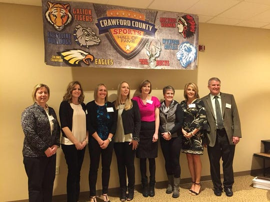 The Hall of Fame Class of 2017, inducted last year, included, from left, Erin Ebner Shawk, Nancy Weithman Ackerman, Tim Gebhardt, Stephanie Striker Burns, Krista Sand Haubert and the 1991 Colonel Crawford State Girls Track team.