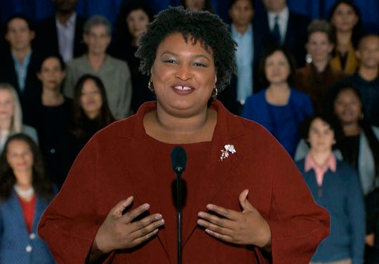 """In this pool image from video, Stacey Abrams delivers the Democratic party's response to President Donald Trump's State of the Union address, Tuesday, Feb. 5, 2019 from Atlanta.  Abrams narrowly lost her bid in November to become America's first black female governor, and party leaders are aggressively recruiting her to run for U.S. Senate from Georgia.  Speaking from Atlanta, Abrams calls the shutdown a political stunt that """"defied every tenet of fairness and abandoned not just our people, but our values."""""""