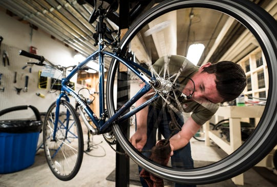 University of Vermont Junior Hunter Gage of Pittstown, N.J., repairs a bike at the UVM Bikes club on Wednesday, February 6, 2019. Hunter worked with Connor Gage at the club at was shocked when he found out that Gage, 19, a freshman from Little Falls, N.Y.,, had died. An autopsy showed that Gage appeared to die from extended exposure to sub-zero temperatures, which was exacerbated by acute intoxication, according to Burlington police. Police believe he attended two fraternity events Friday evening and into Saturday morning.