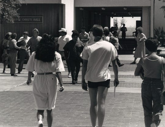Students at Corpus Christi State Univeristy walk past Corpus Christi Hall on campus in the late 1980s.