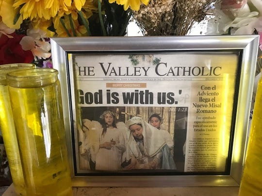 A framed newspaper article on the altar of La Lomita Chapel.